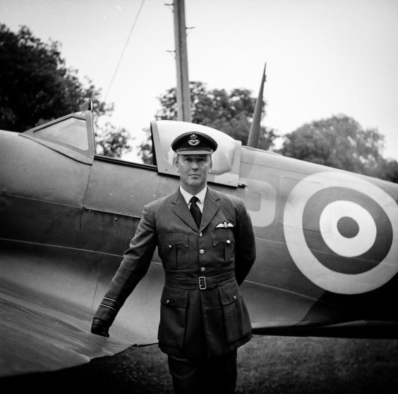 Wayne Ladd reenacting as an RAF Squadron Leader in the Battle of Britain at the War & Peace Revival in Folkestone, England on July 20, 2013, in front of a replica Spitfire.
