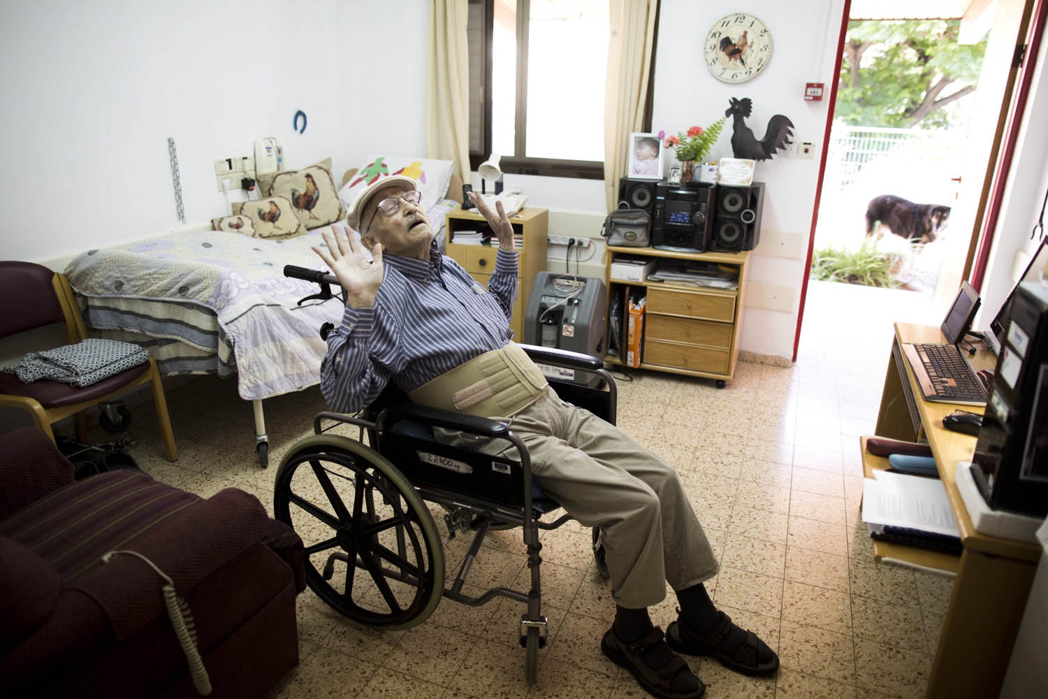 Holocaust survivor Moshe Roth, 81, a writer and painter born in Nancy, France, relaxes after smoking medical marijuana in the Hadarim Nursing home in Kibbutz Naan, near Rehovot, Israel on April 27, 2014.