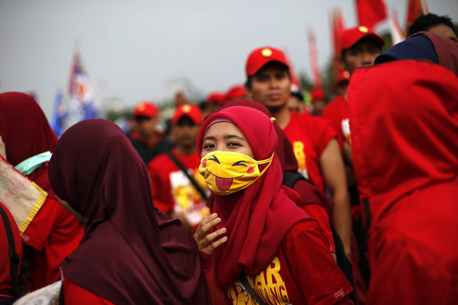 An Indonesian worker wears a pikachu Japanese character mask during a rally to mark the International Labor Day outside the presidential palace in Jakarta, Indonesia, May 1, 2014.
