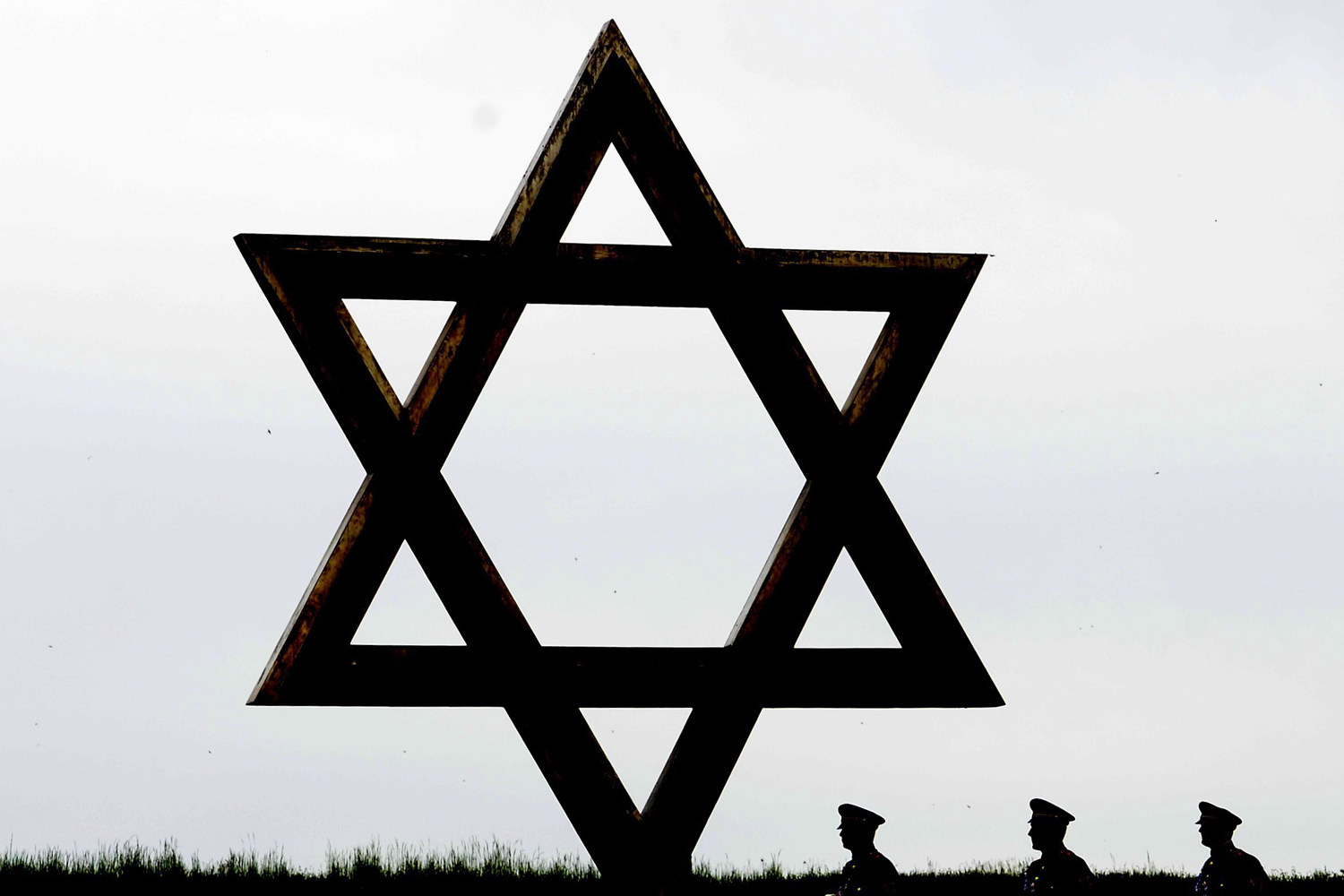 May 6, 2014. Soldiers walk behind a Star of David during the visit of German President Joachim Gauck (unseen) to the former Nazi concentration camp  Terezin (Theresiendstadt), Czech Republic.