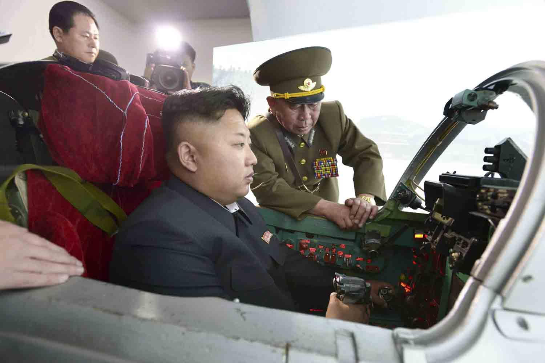 May 15, 2014. North Korean leader Kim Jong-un (C) learns to fly an airplane at a North Korean Air Force unit.