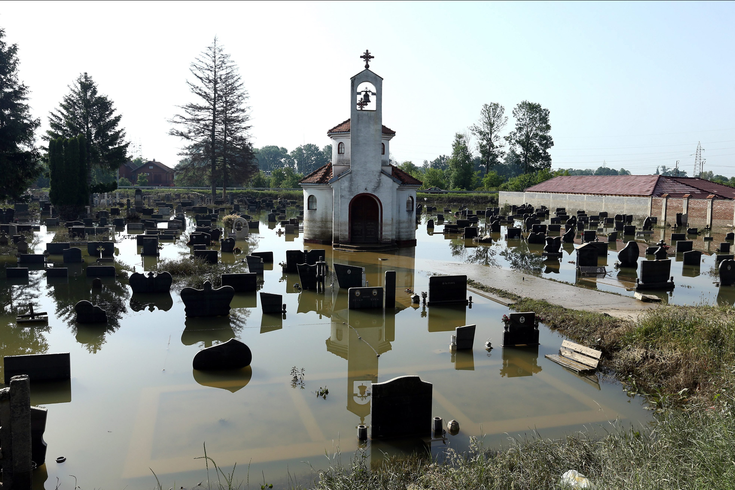 May 23, 2014. A cemetery at the entrance of the town of Bosanski Samac, in the northern part of Bosnia and Herzegovina, some 250 kilometers from the Bosnian capital Sarajevo, is still under flood water.