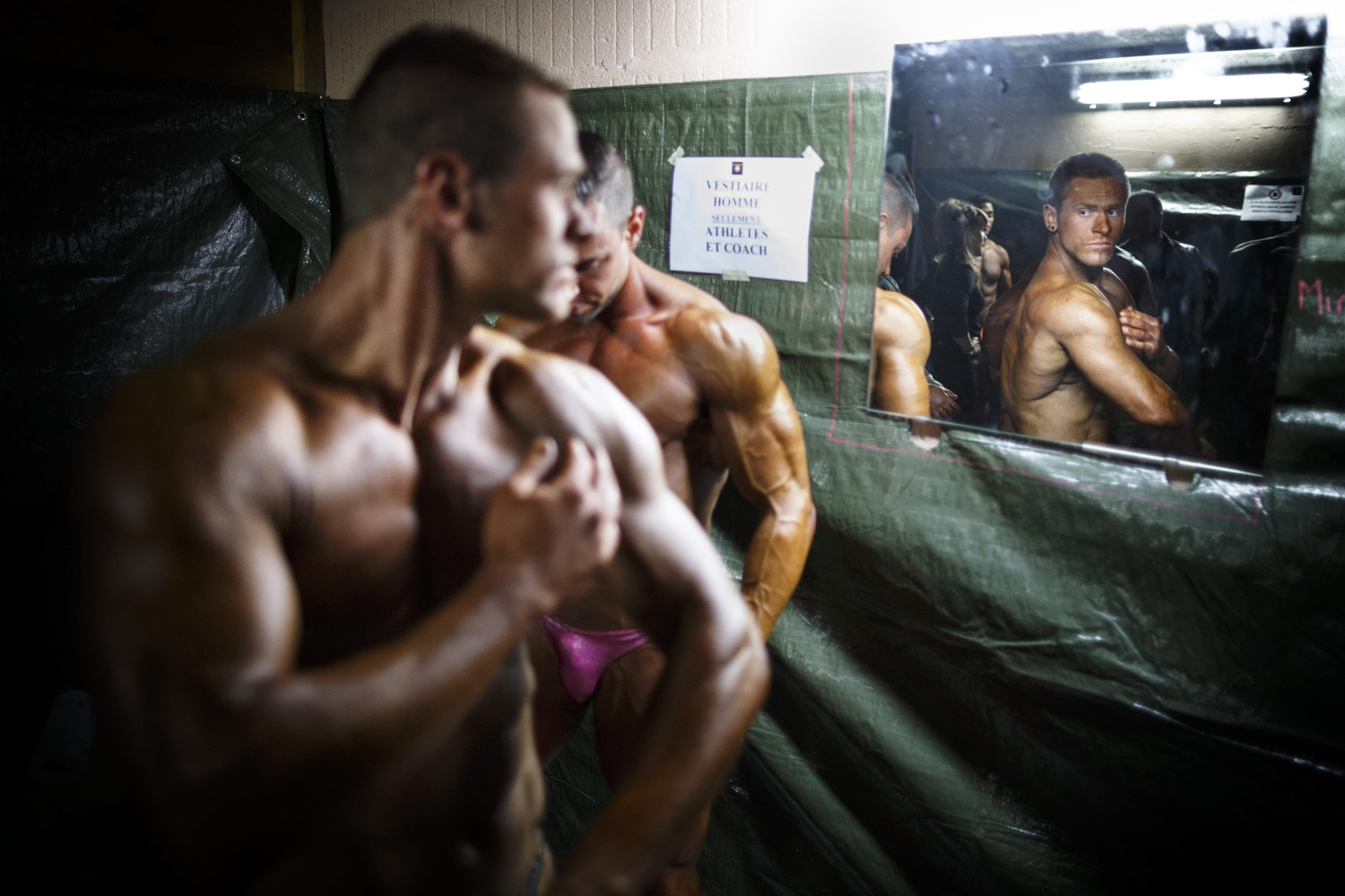 May 25, 2014. A bodybuilder applies self-tanning lotion on his body prior to the final event of the World Amateur Bodybuilding Association (WABA) Swiss fitness and bodybuilding championships in Epalinges near Lausanne, Switzerland.