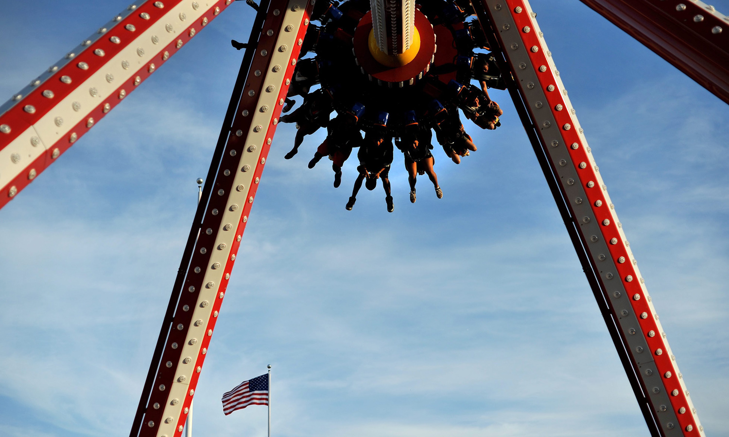 A group of people are flipped upside down the Luna 360, an amusement ride at Coney Island in Brooklyn, N.Y., on May 26, 2014.