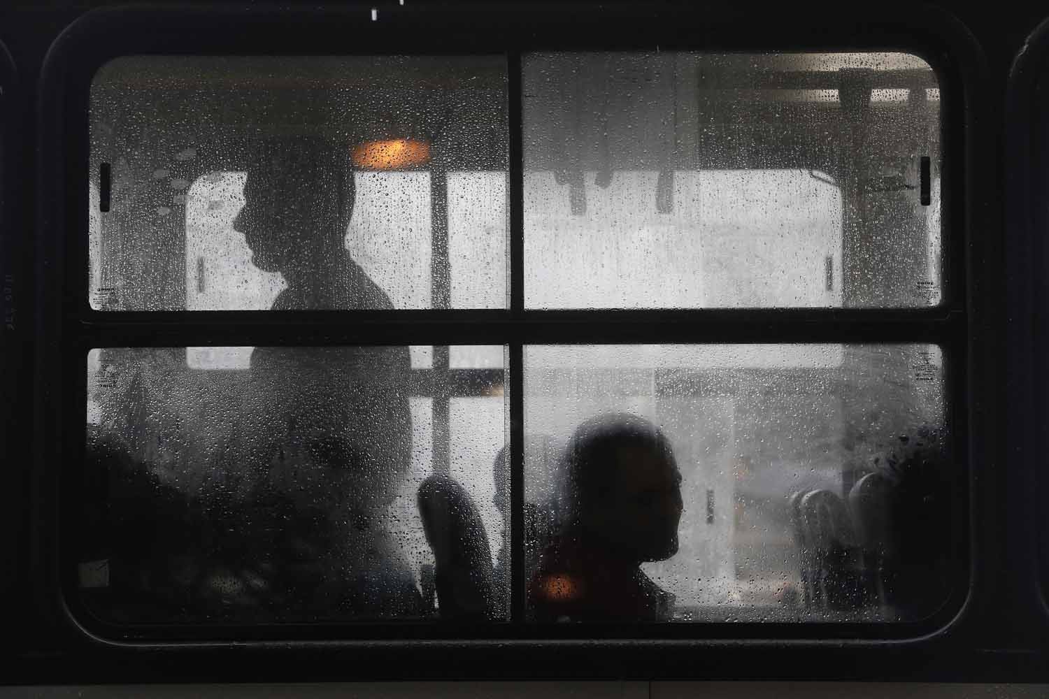 May 28, 2014. Commuters take their seats in one of the few buses operating during a 24-hour bus strike in Rio de Janeiro, Brazil.