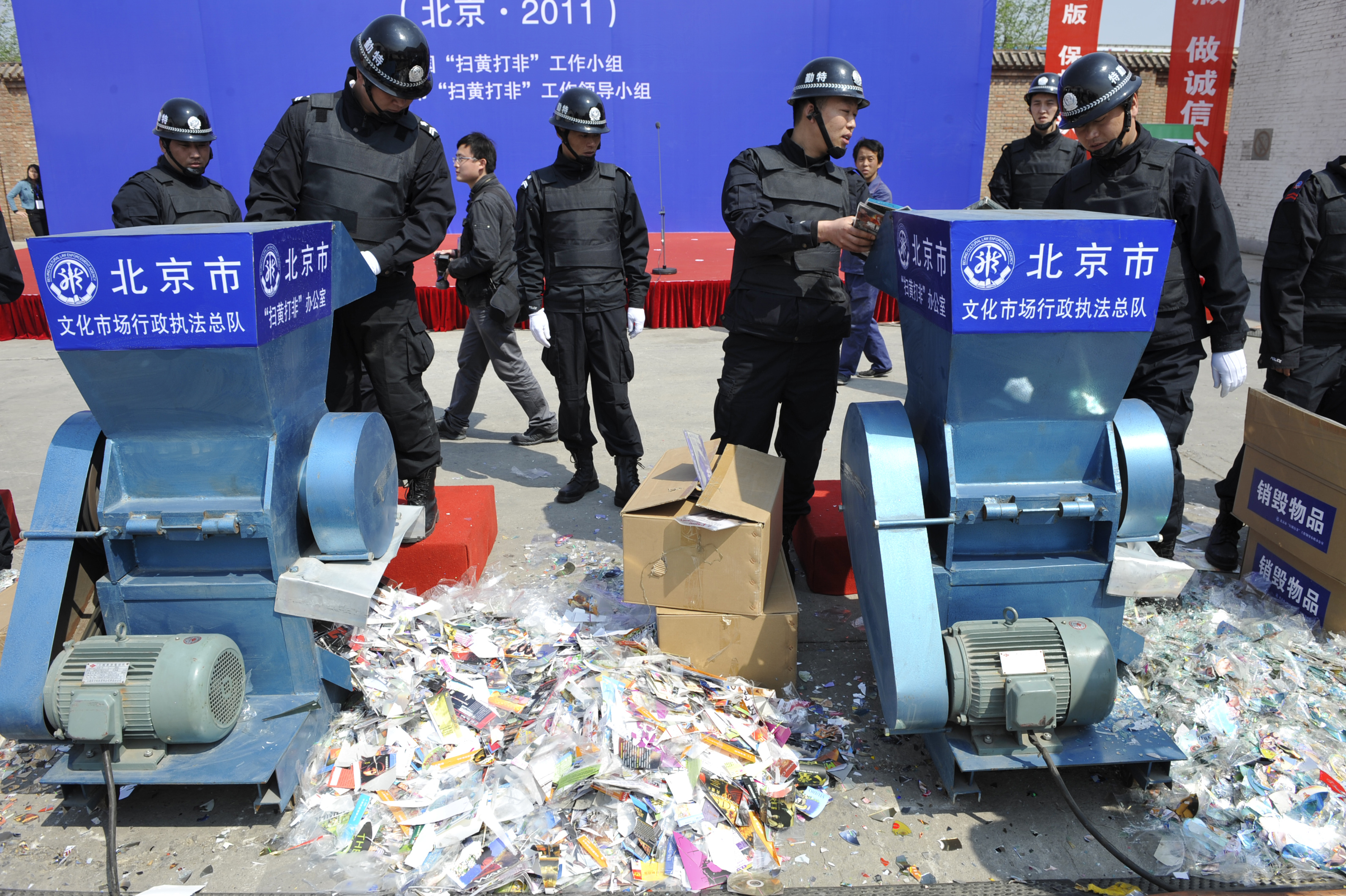 Chinese officials launch a ceremony to destroy thousands of pornographic books and video materials in Beijing on April 24, 2011.