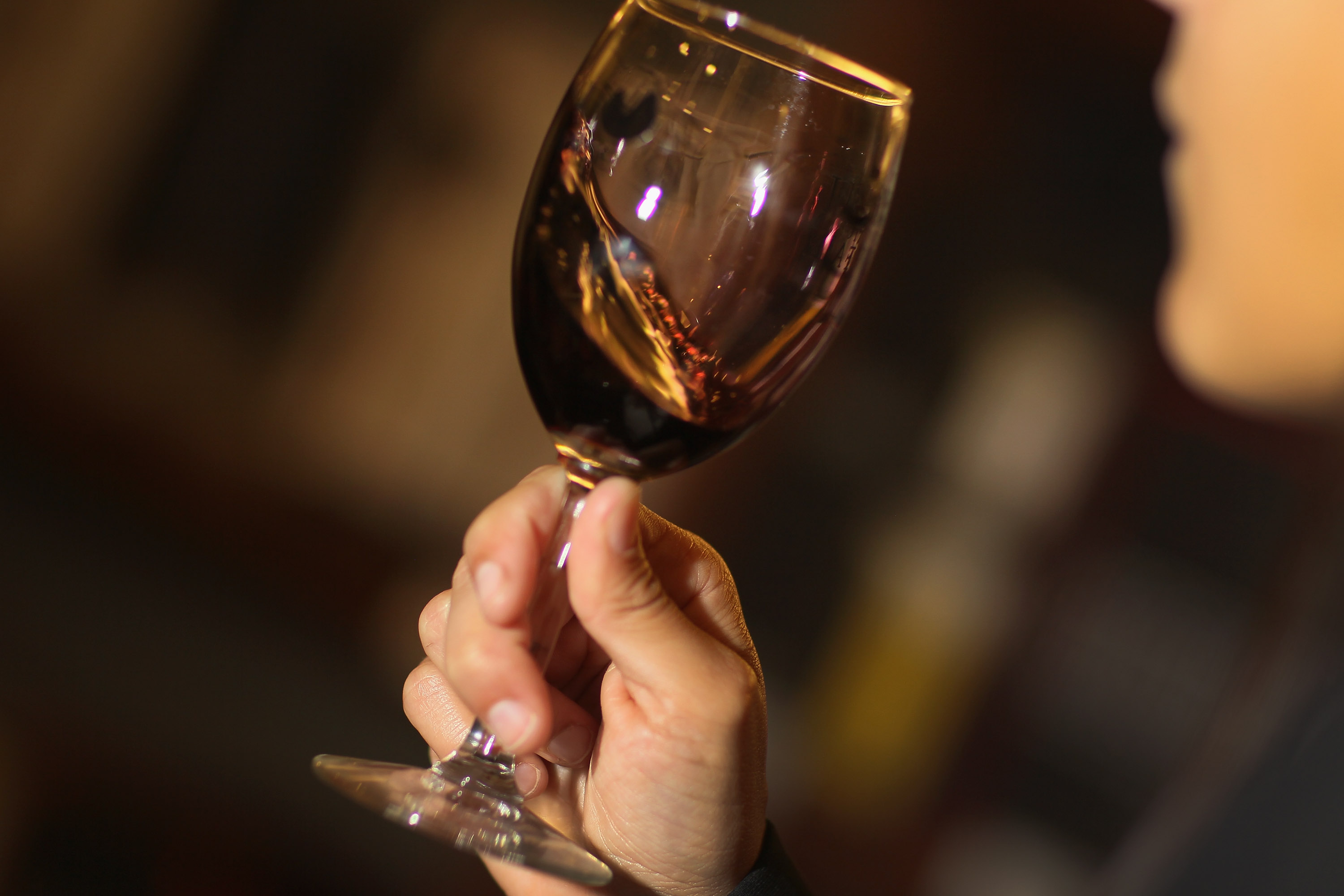 Monica De Abreu tastes a red wine as she decides which wines to purchase to sell at Global Liquors store on June 6, 2011 in Miami, Florida.
