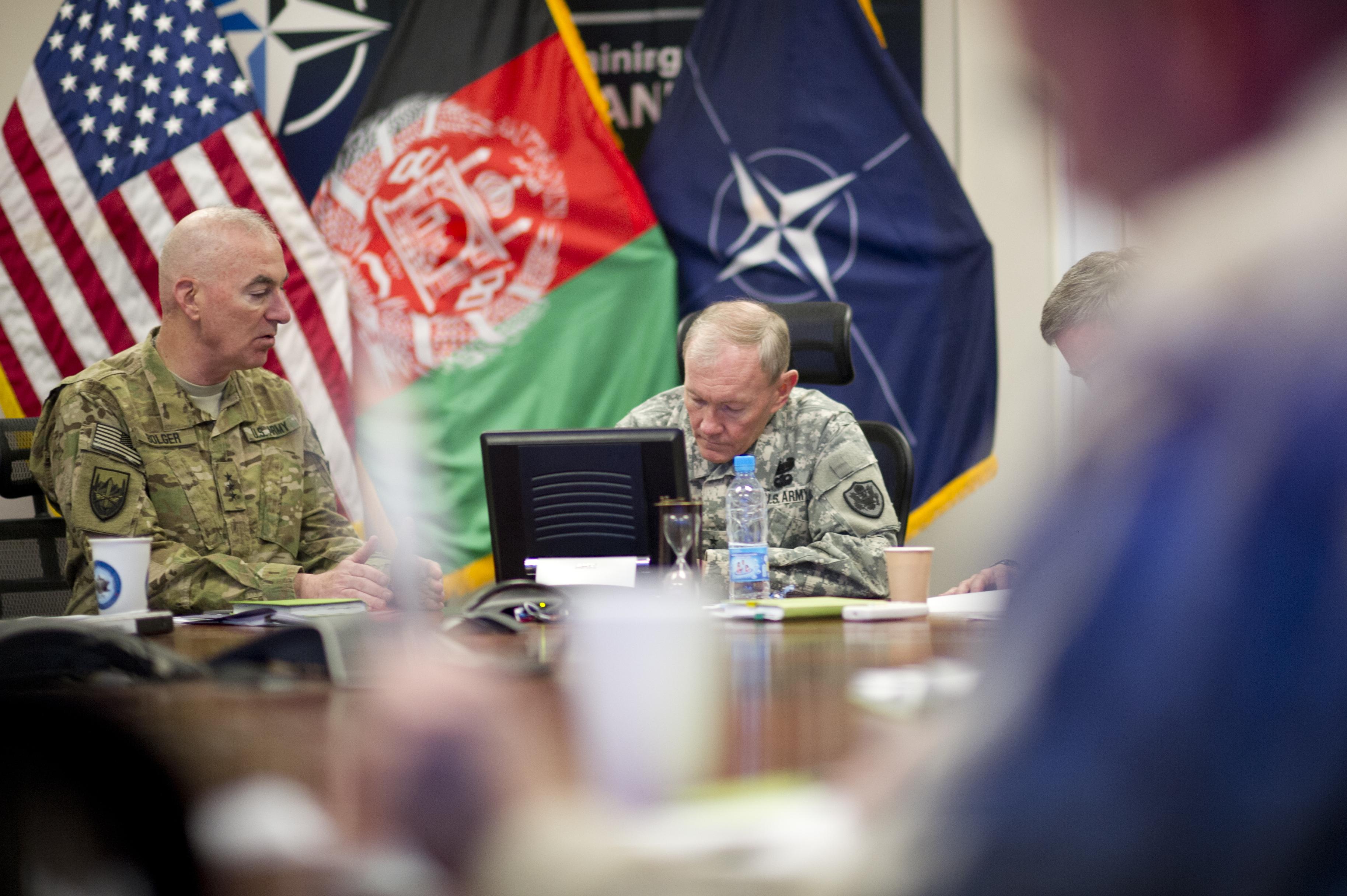 Army Lt. Gen. Daniel Bolger, left, briefs Gen. Martin Dempsey, chairman of the Joint Chiefs, on progress in Afghanistan in 2012.
