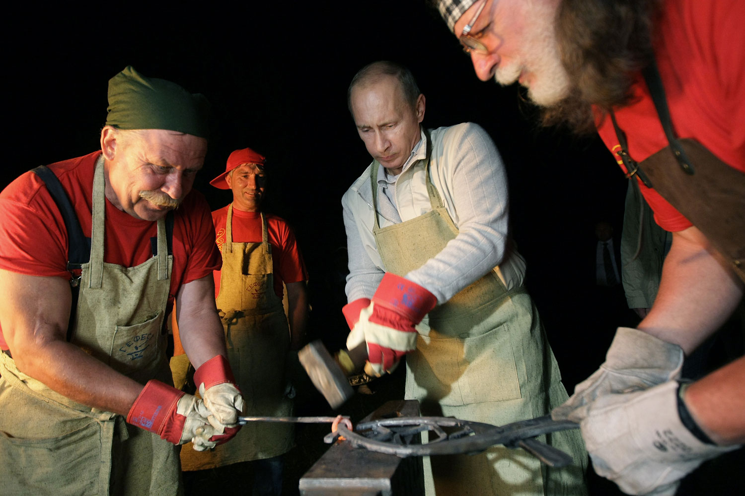 Earlier in the trip, Putin visited the Architecture and Ethnography Museum in Irkutsk, where he worked with a pair of blacksmiths, Aug. 1, 2009.