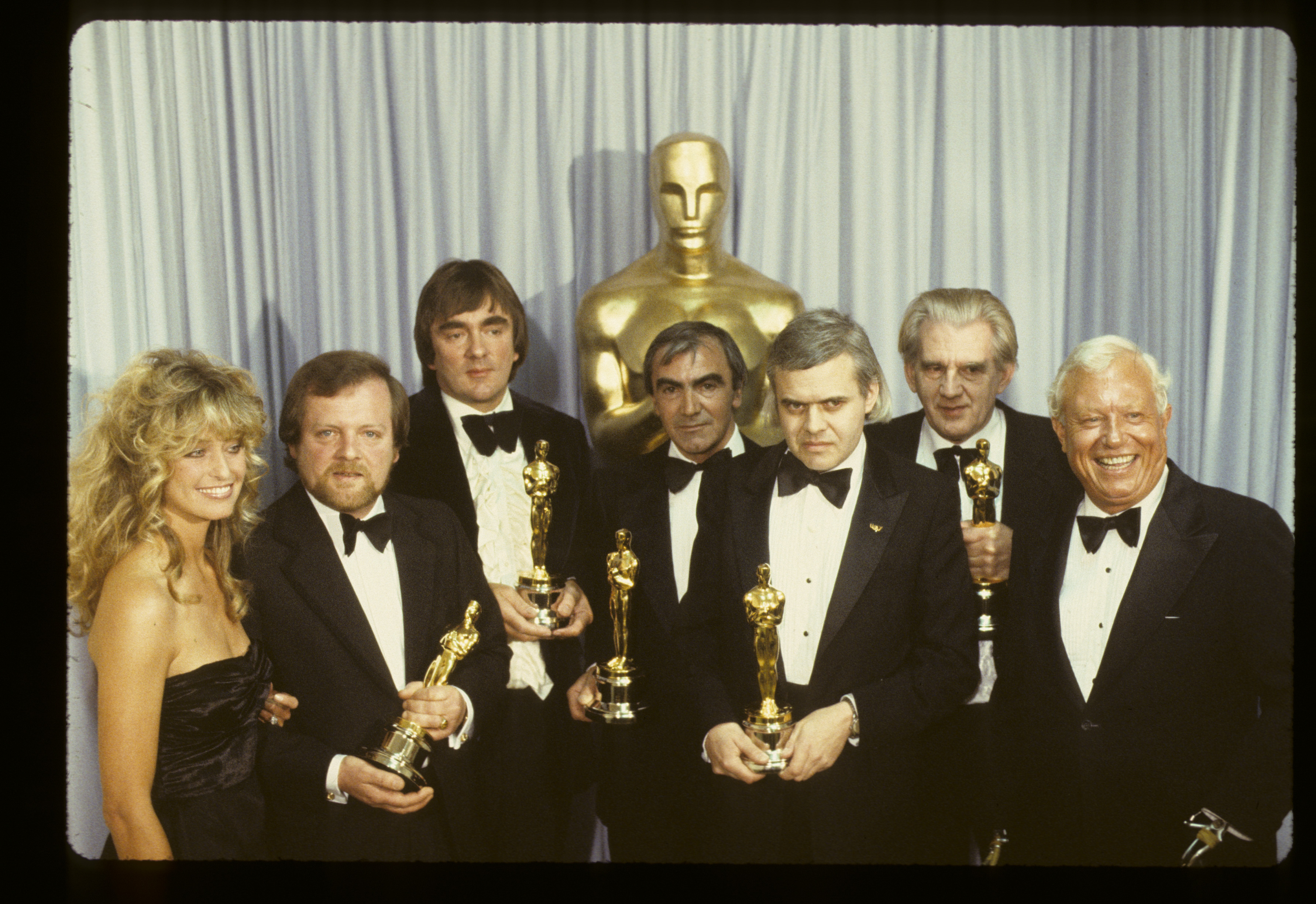 PRESENTERS FARRAH FAWCETT AND HAROLD RUSSELL (R) WITH BEST VISUAL EFFECTS OSCAR WINNERS (2ND FROM L-R): H.R. GIGER, CARLO RAMBALDI, BRIAN JOHNSON, NICK ALLDER, DENYS AYLING