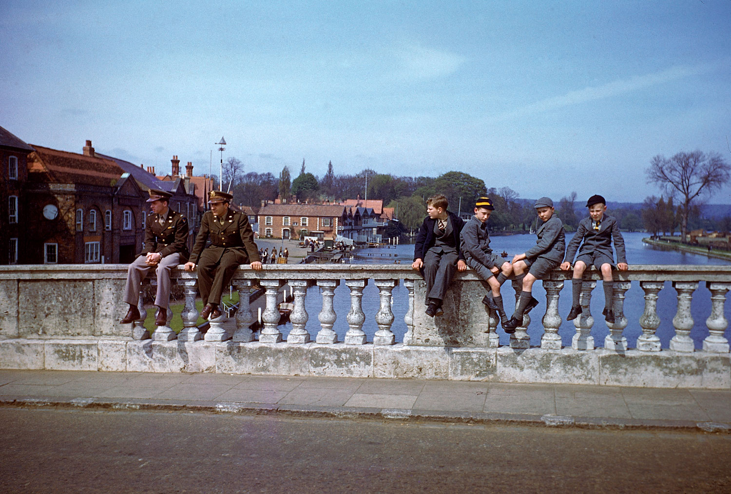 Troops and civilians pass the time on Henley Bridge, Henley-on-Thames, in the spring of 1944.