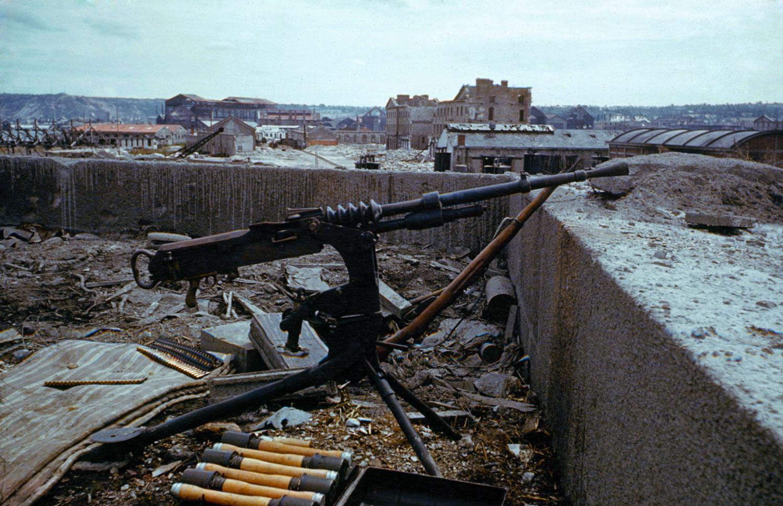 An abandoned German machine gun, France, June 1944.