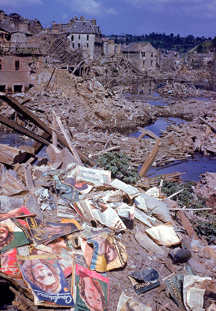 Magazines scattered among the rubble of the heavily bombed town of Saint-Lô, Normandy, France, summer 1944.