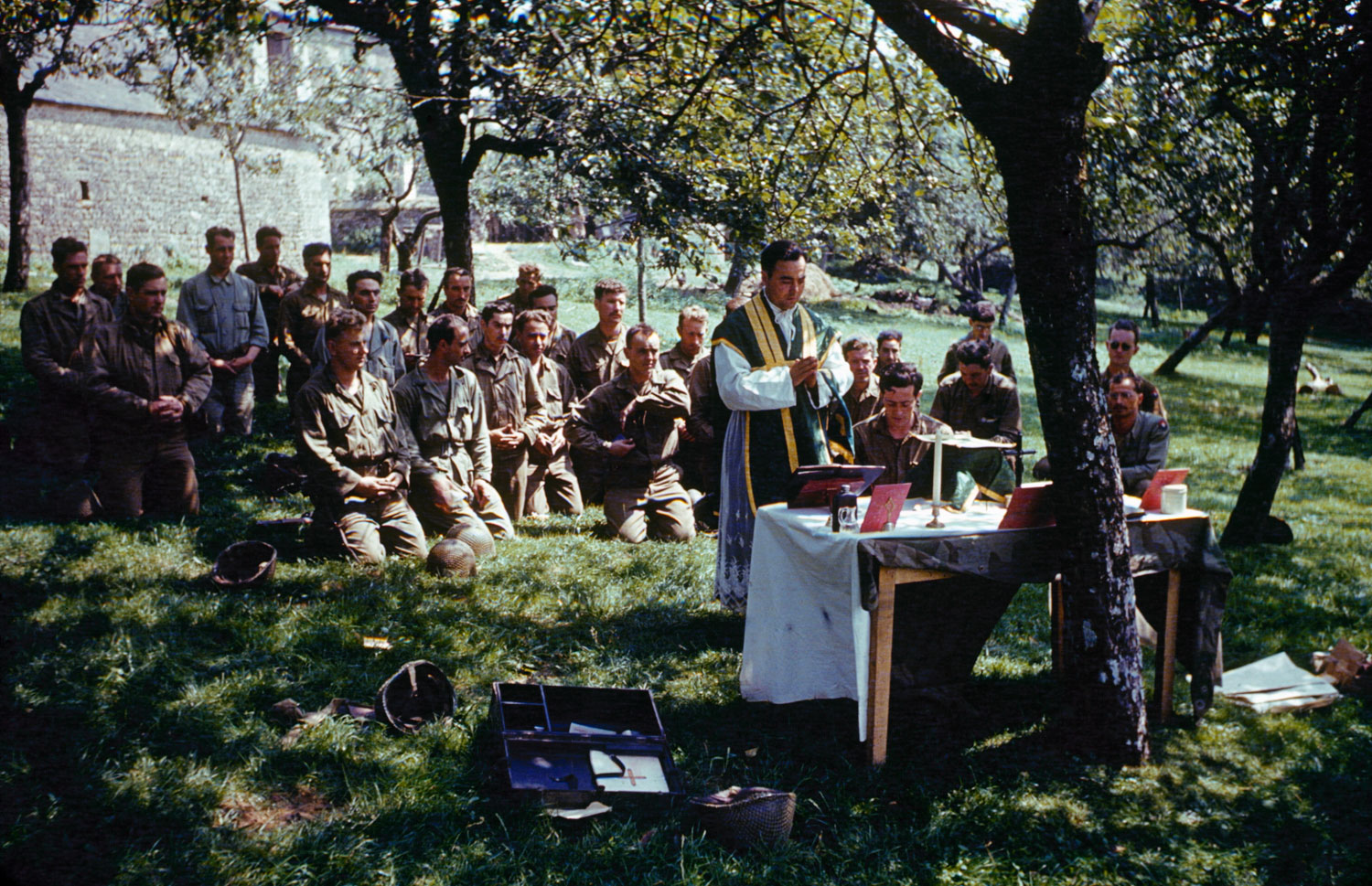 Church services in dappled sunlight, France, 1944.