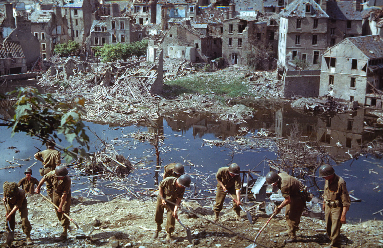 American troops clear wreckage in Saint-Lô, Normandy, 1944.