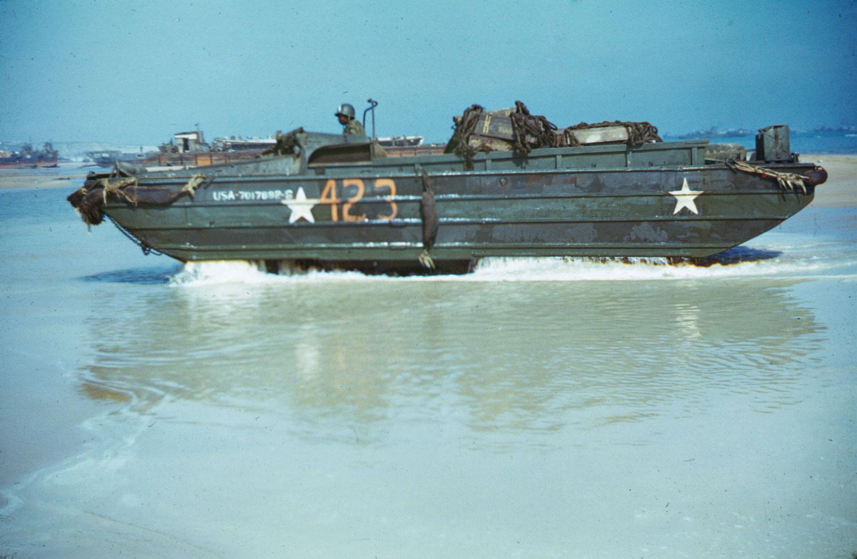 An amphibious  duck  comes ashore from its landing craft, Normandy, summer 1944.