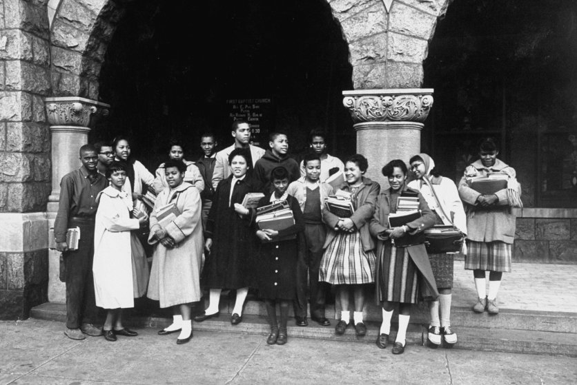 Seventeen of the African American students who were ordered admitted to white schools in Norfolk, Va., pose for a photo at a church where they had been getting private schooling, 1959.