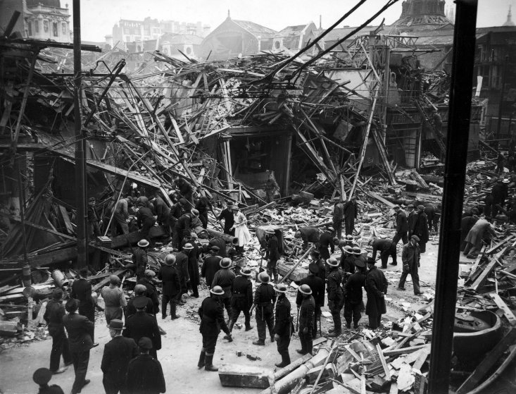 "Rescue workers help pull victims from ruins of a building hit by a German V-1 ""flying bomb"" rocket, July 1944."