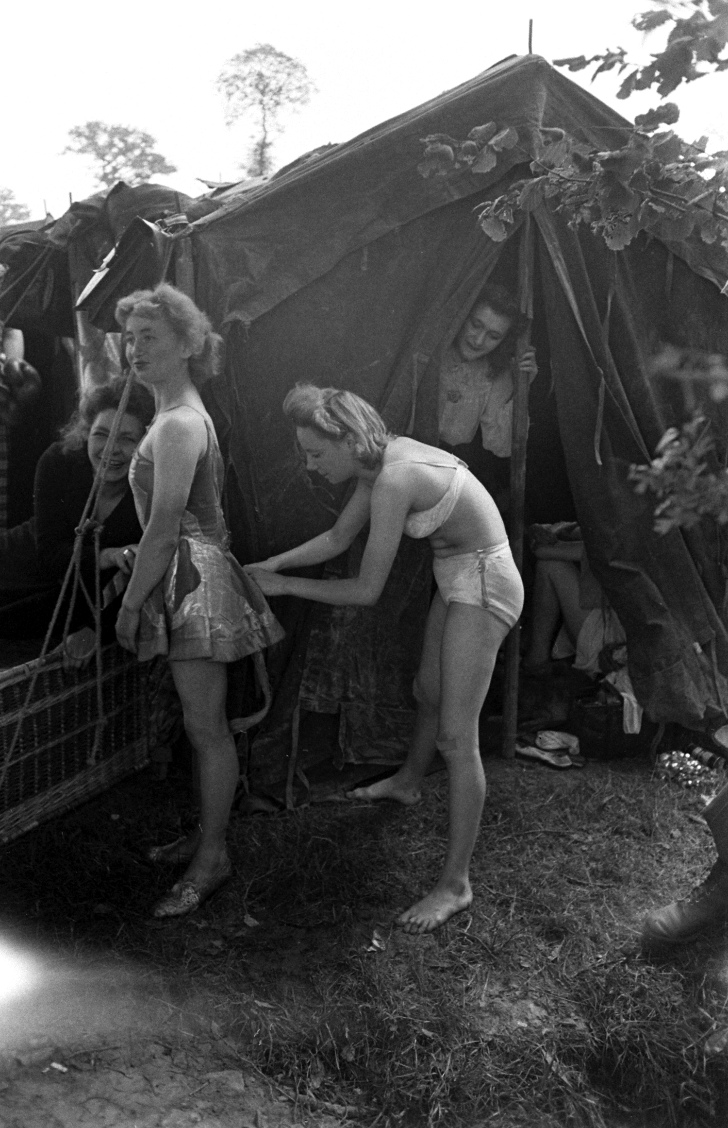 Performers backstage at show for U.S. troops after D-Day, Normandy, 1944.