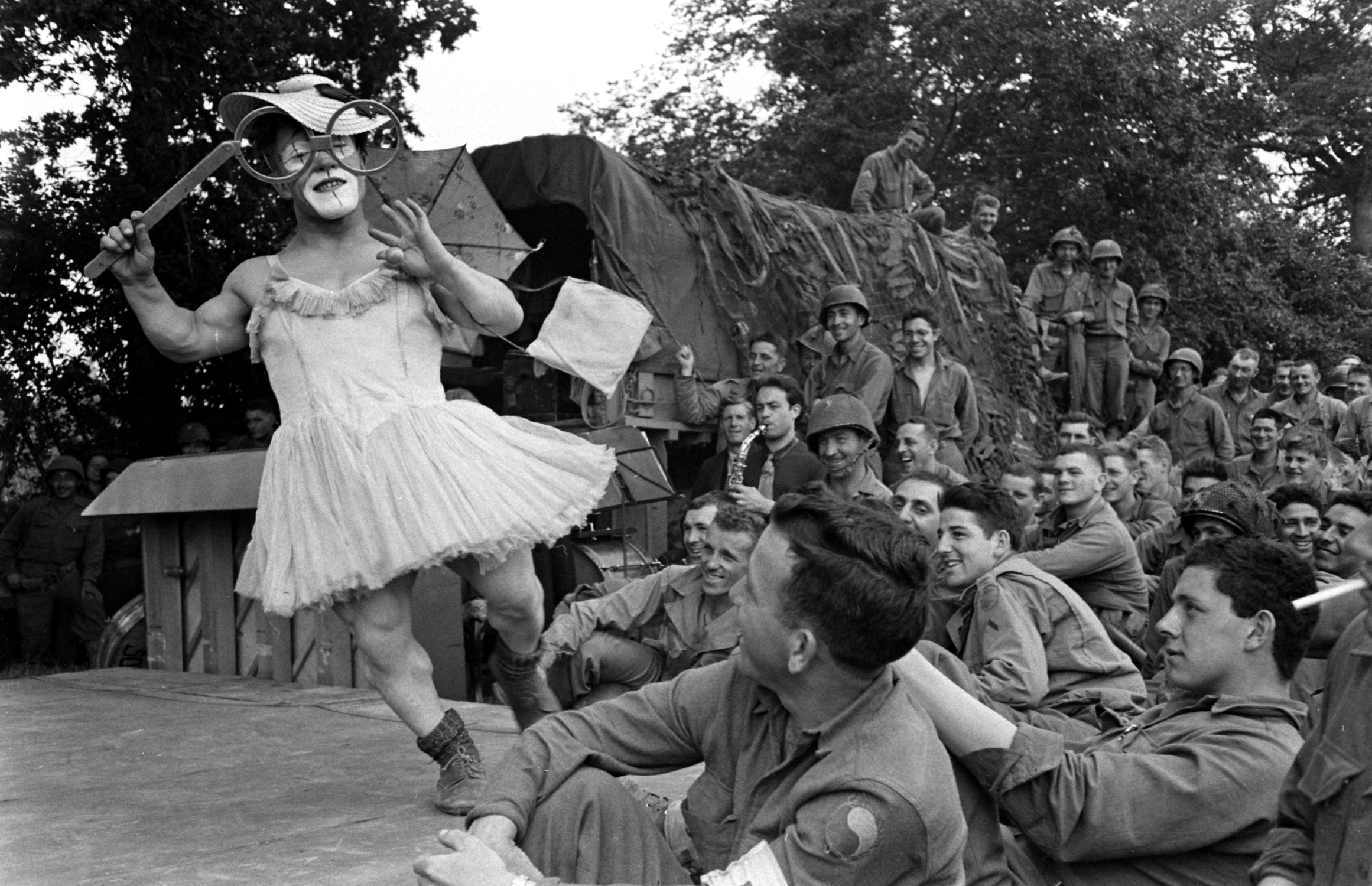 A clown on stage at show for U.S. troops after D-Day, Normandy, 1944.