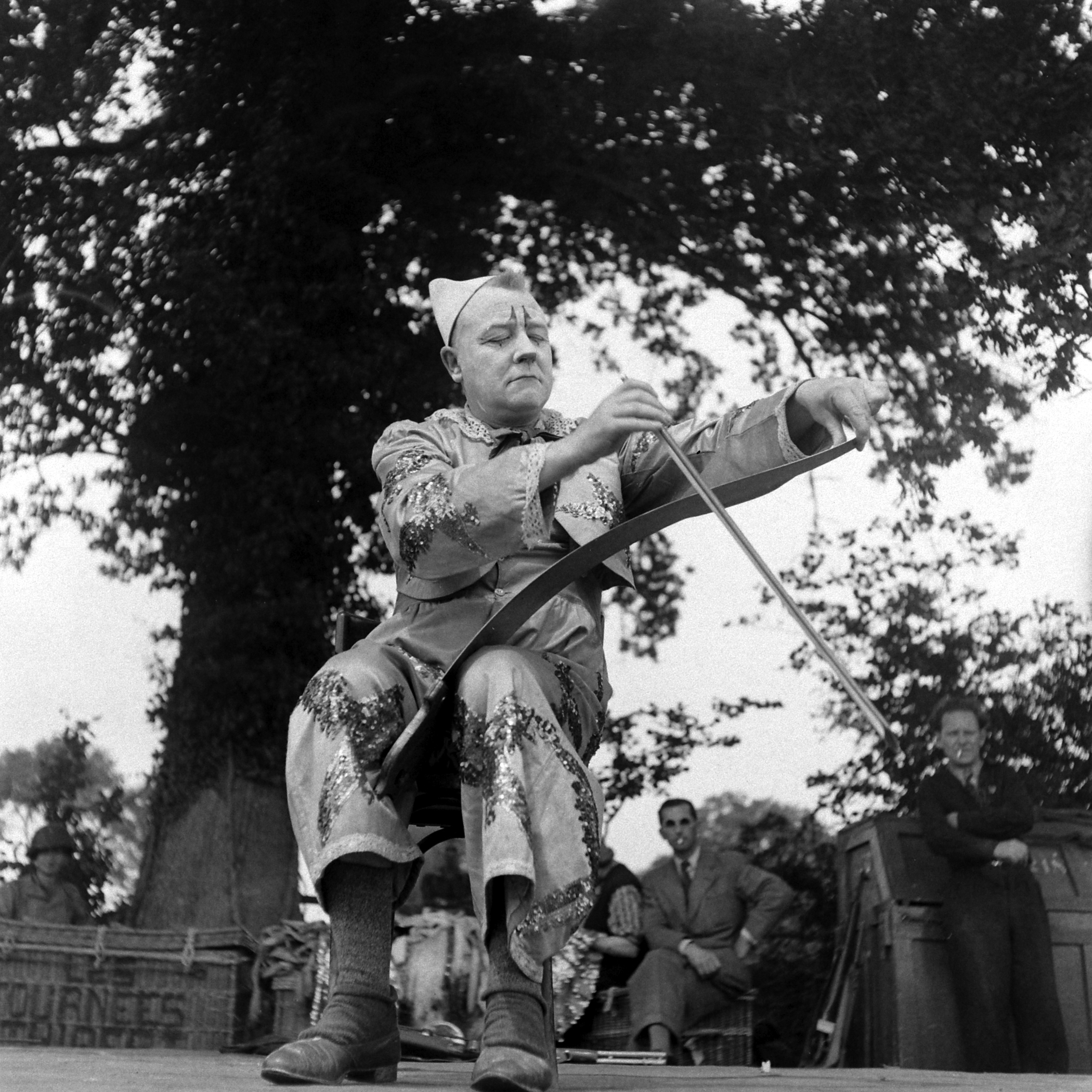 French clown, Danglais, performs in show for U.S. troops after D-Day, Normandy, 1944.