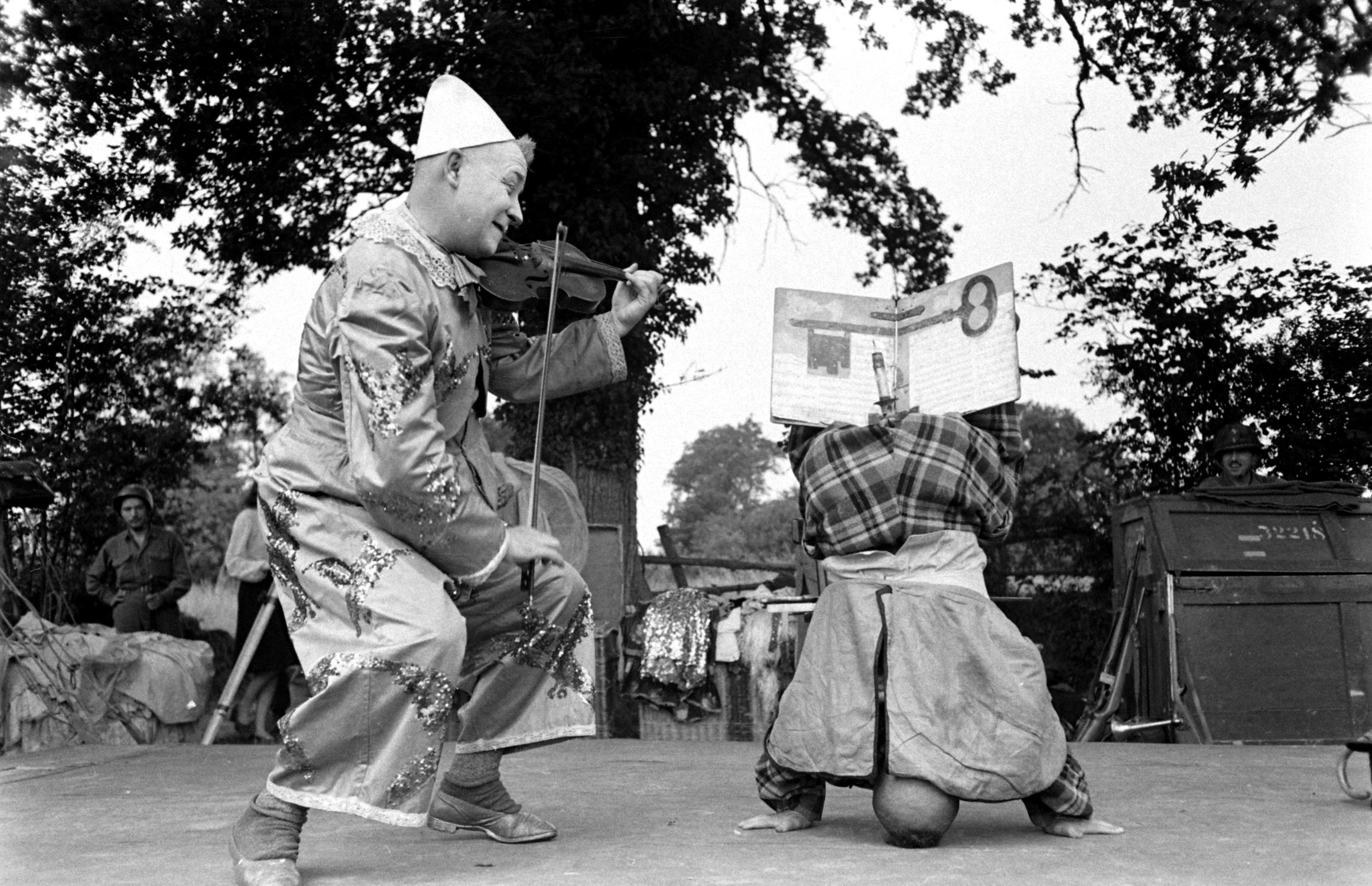 Clowns in show for U.S. troops after D-Day, Normandy, 1944.