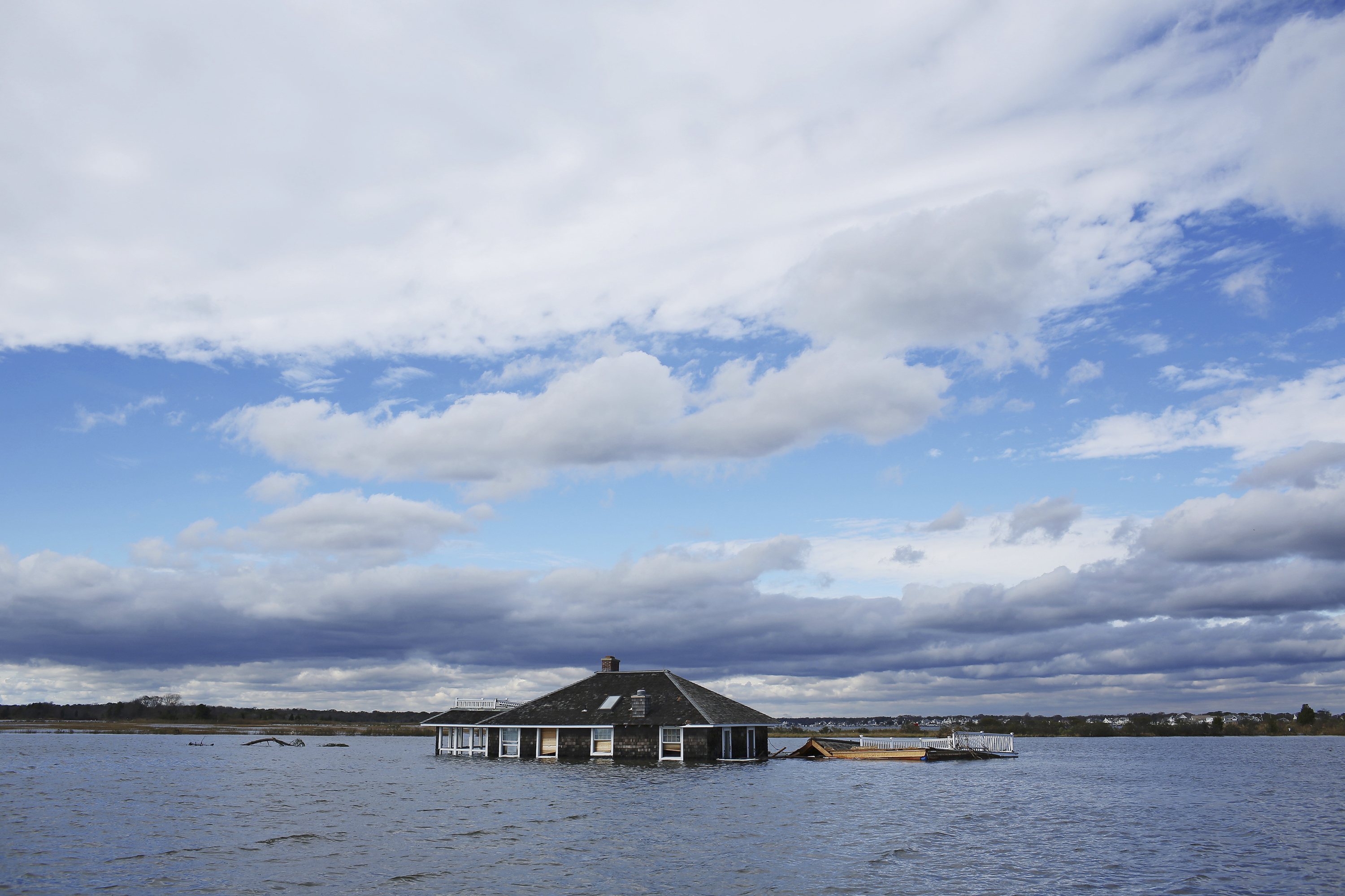 Deep trouble.A shore house near Mantoloking, N.J., sits in a lagoon after Superstorm Sandy in October 2012.