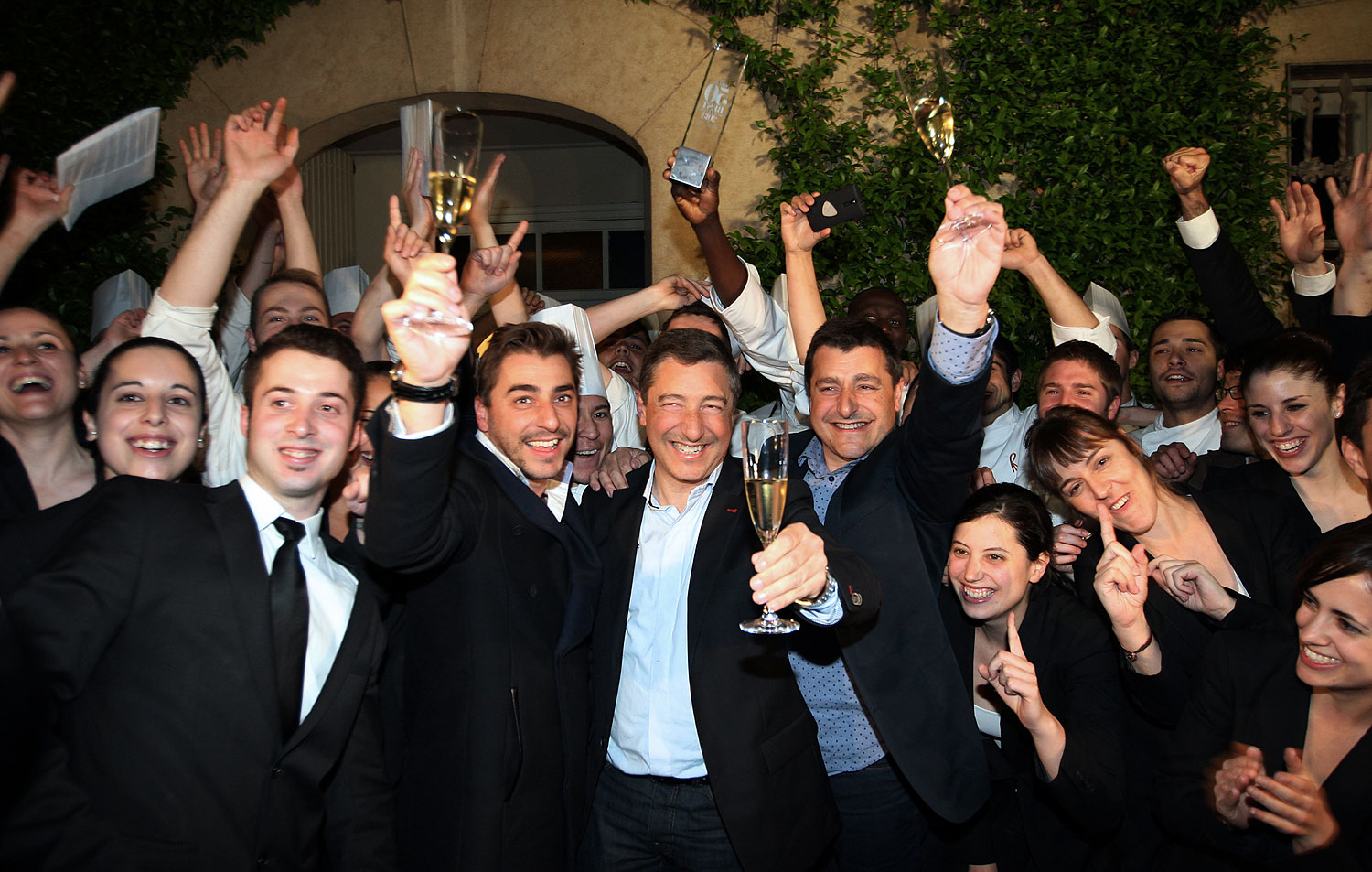 Spanish Chefs of  El Celler de Can Roca  Joan Roca, center, Jordi Roca, left, and Josep Roca, right, pose with their employees at the restaurant in Girona on April 30, 2013.