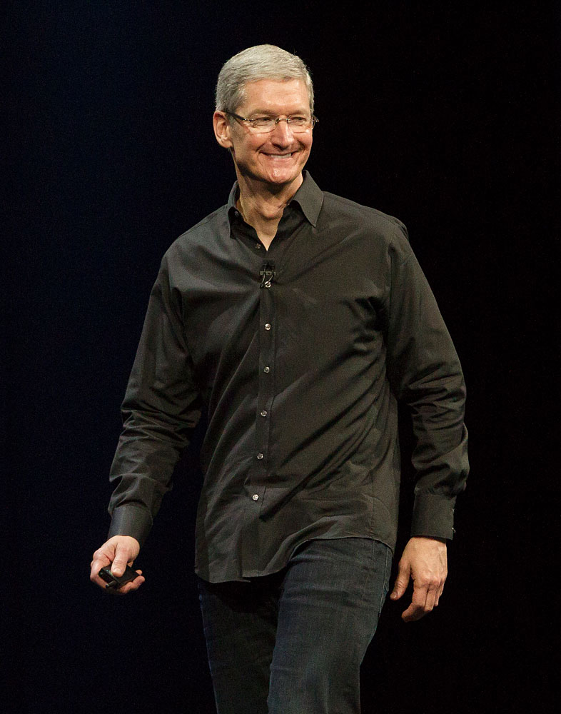 Apple CEO Tim Cook waves during the keynote address during the 2013 Apple Apple Worldwide Developers Conference at the Moscone Center on June 10, 2013 in San Francisco.