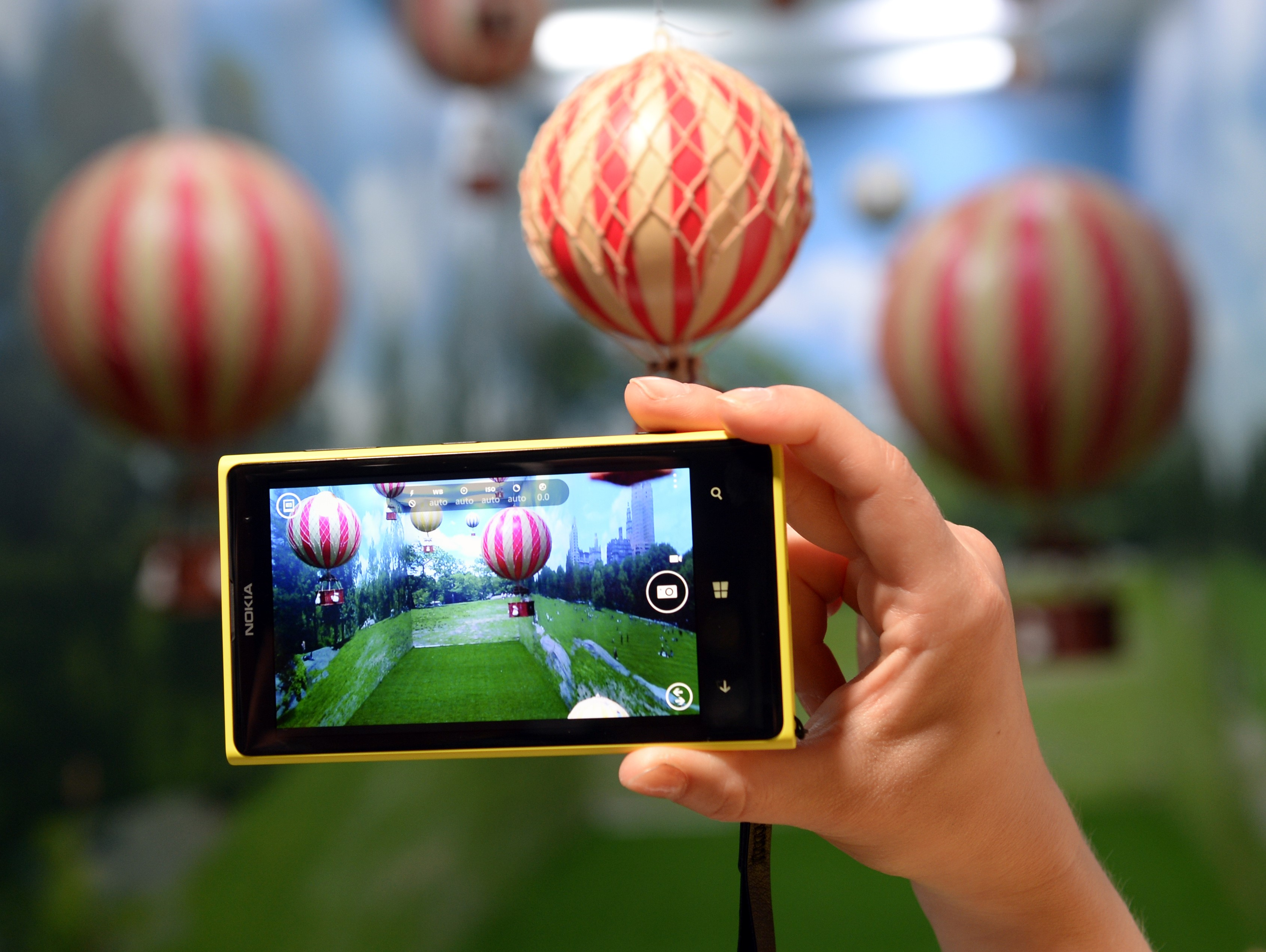 A employee demonstrates the photo capabilities of the Nokia Lumia 1020, a Windows Phone with a 41-megapixel camera after its unveiling in New York City July 11, 2013.