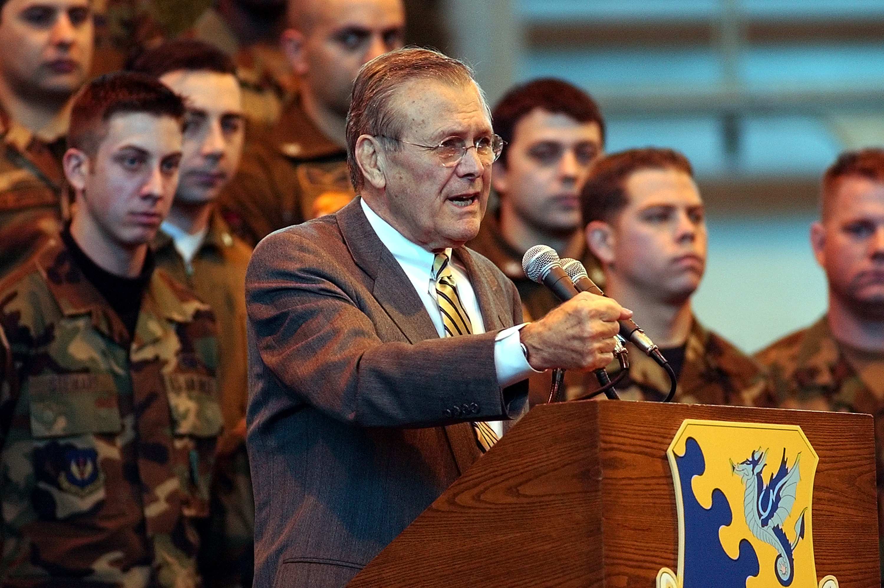 U.S. Defense Secretary Donald Rumsfeld speaks to troops in Italy.