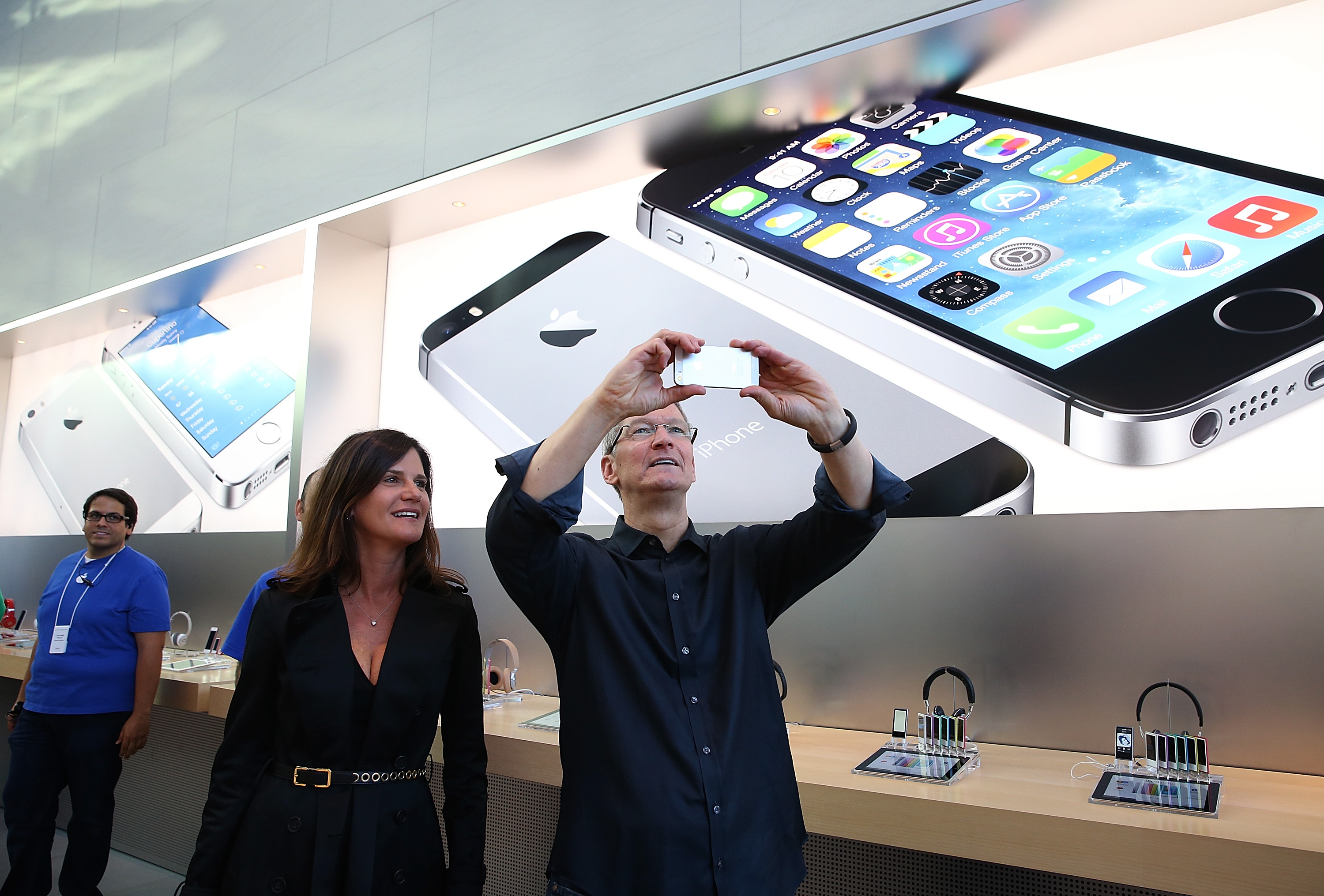 Katie Cotton and Tim Cook