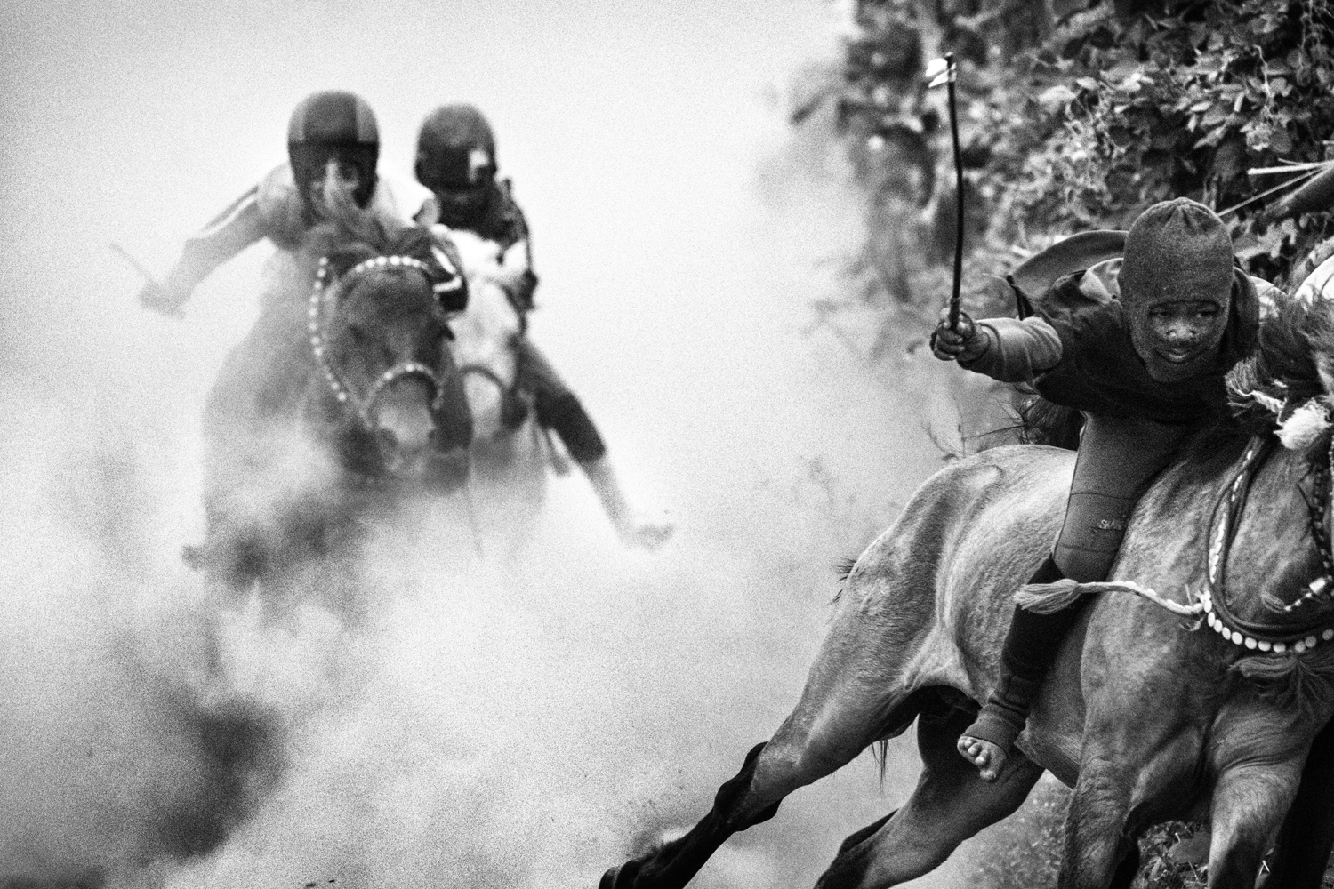 The following series of images was taken on the island of Sumbawa, West Nusa Tenggara, Indonesia.                                                              August 5, 2010. Jockeys are seen during a race.