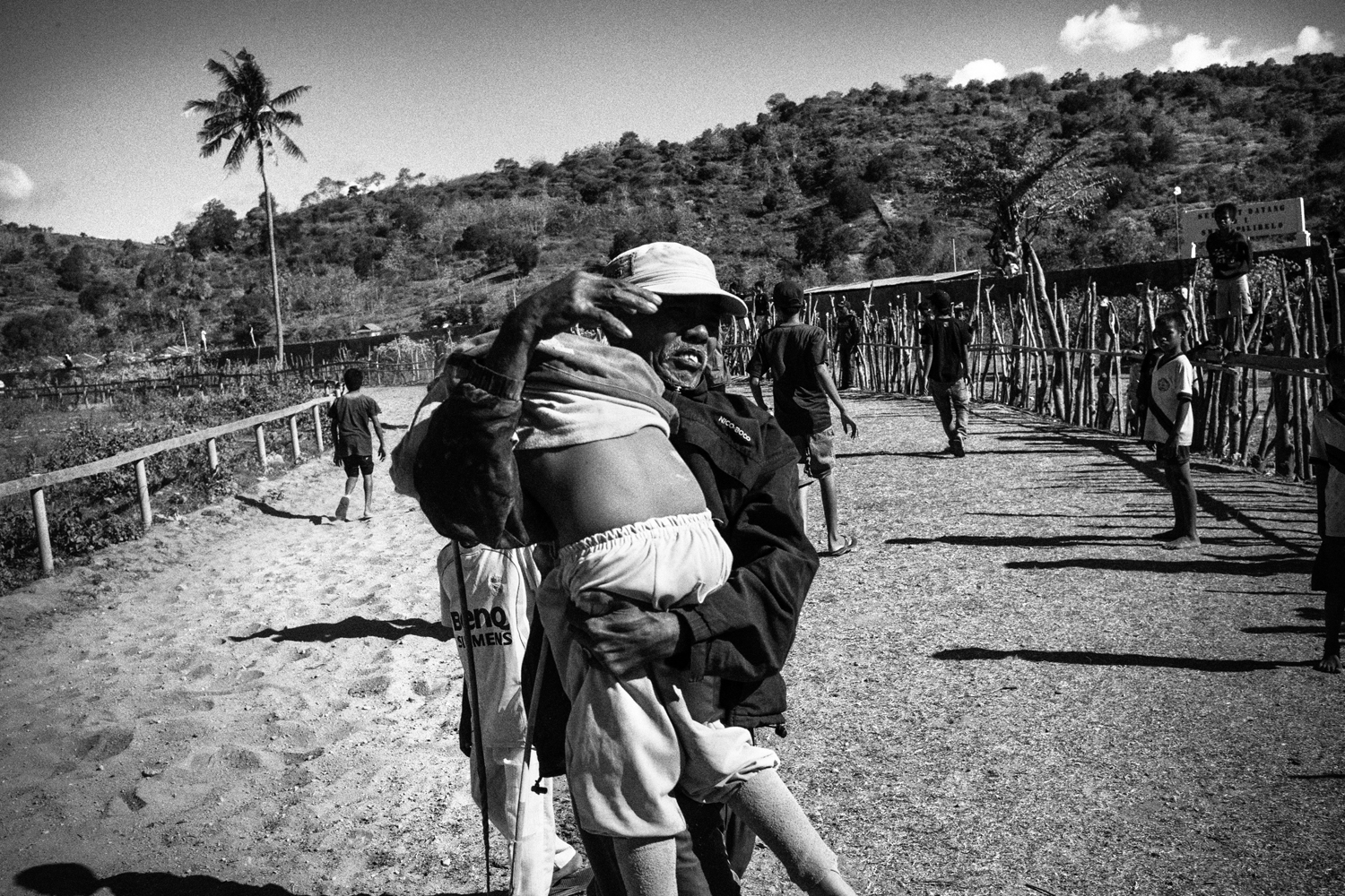 July 14, 2012. A jockey is held by his father after a race.