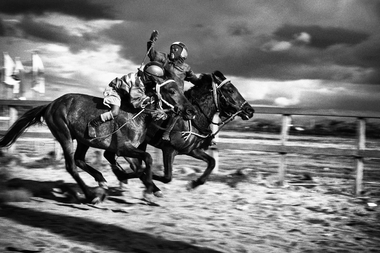 April 14, 2013. Jockeys are seen racing.