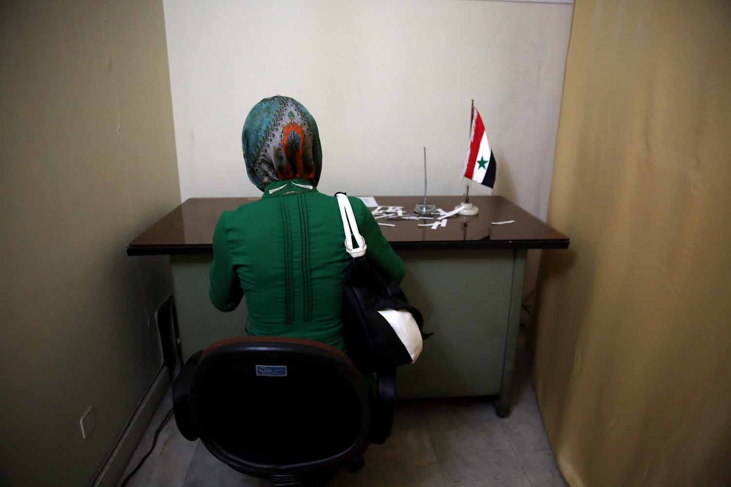 May 28, 2014. A Syrian woman who lives in Iran fills in the ballot for her country's presidential election at the Syrian Embassy in Tehran, Iran.
