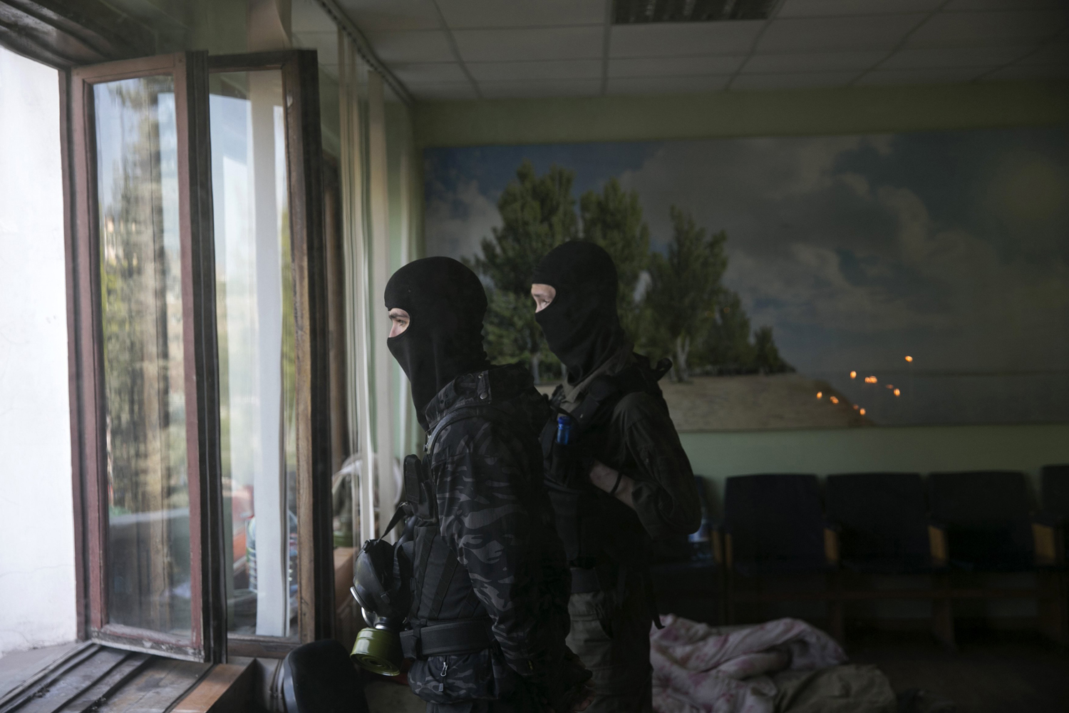 April 26, 2014. Pro-Russian masked men stand watch inside the Mariupol town hall in east Ukraine.