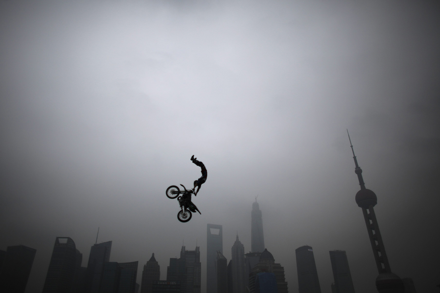 Joel Brown of Australia performs during a presentation of the World Extreme Games in Shanghai on April 27, 2014.