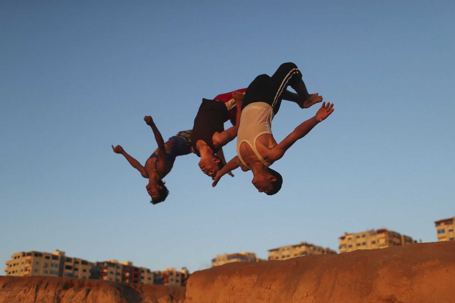 Palestinian youths practice their parkour skills at the Shati refugee camp in Gaza City on April 27, 2014.