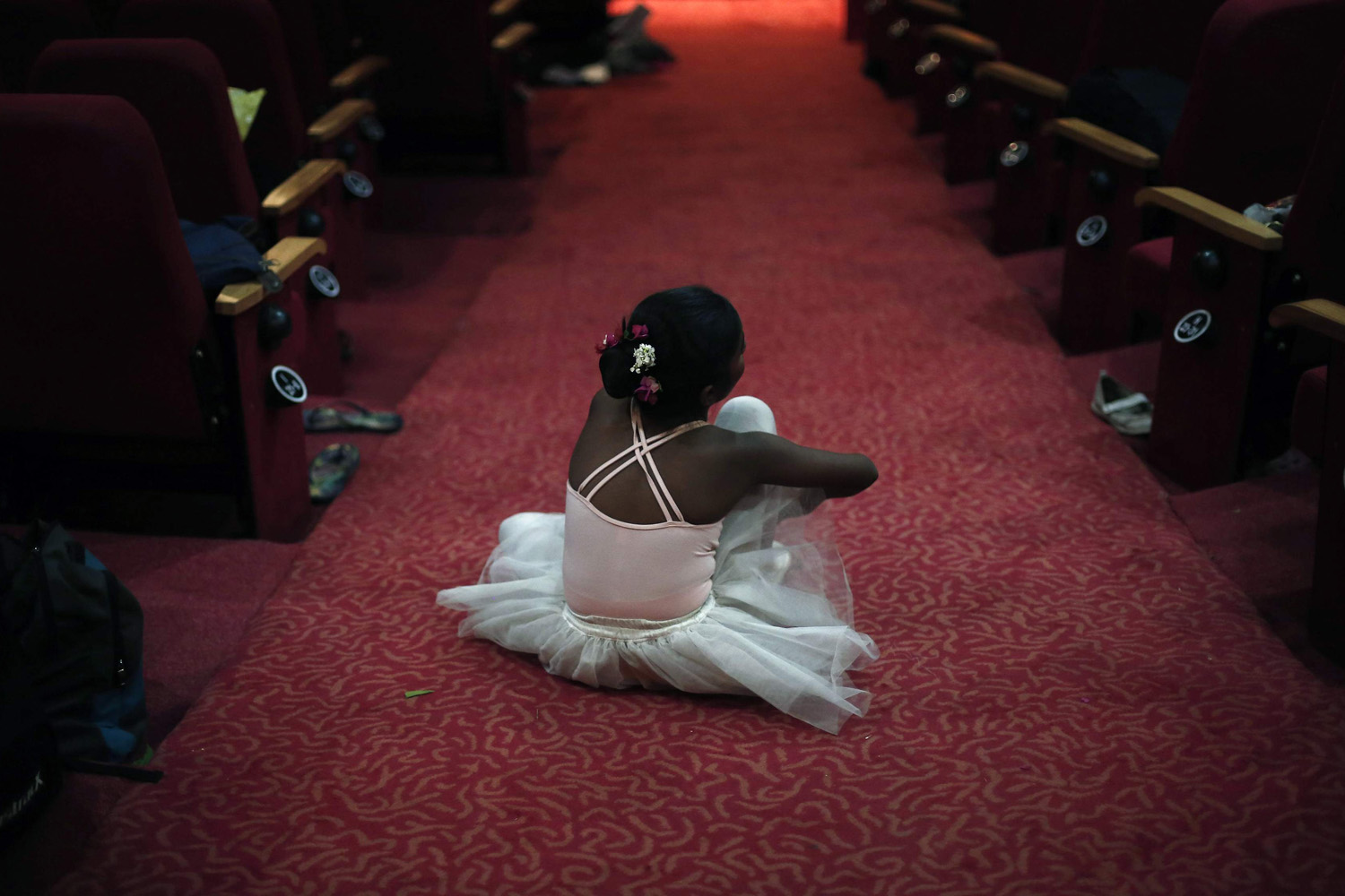 Apr. 29, 2014. A girl sits backstage after getting ready for her dance recital to celebrate International Dance Day, in New Delhi, India.