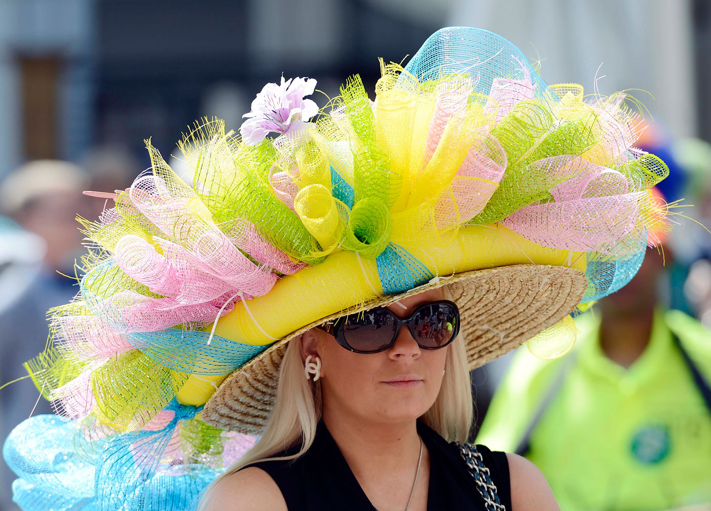 Ashley Cebak in a bright pink, green and yellow derby hat.