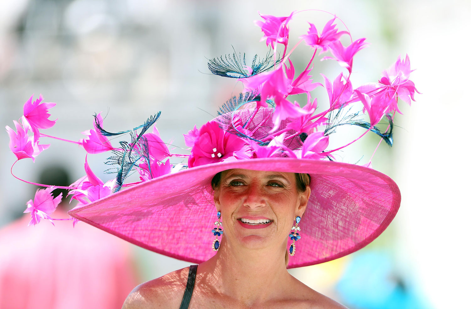 Tracy Abney before the in a bright pink Derby hat.