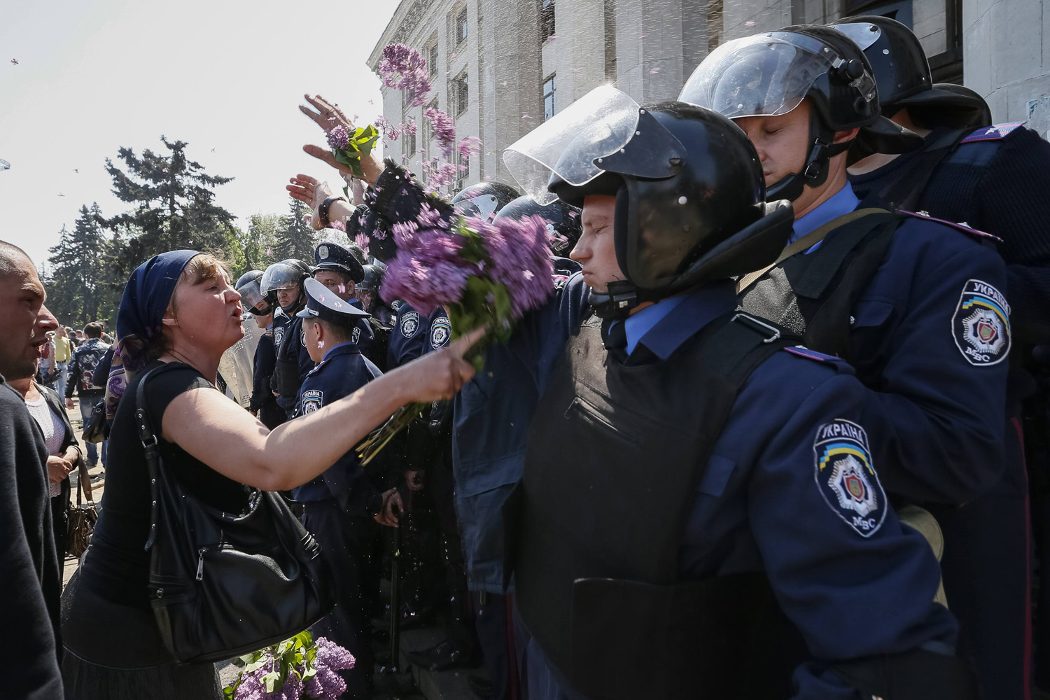 May 3, 2014. A woman argues with members from the Ukrainian Interior Ministry security forces during a rally outside a trade union building in Odessa.