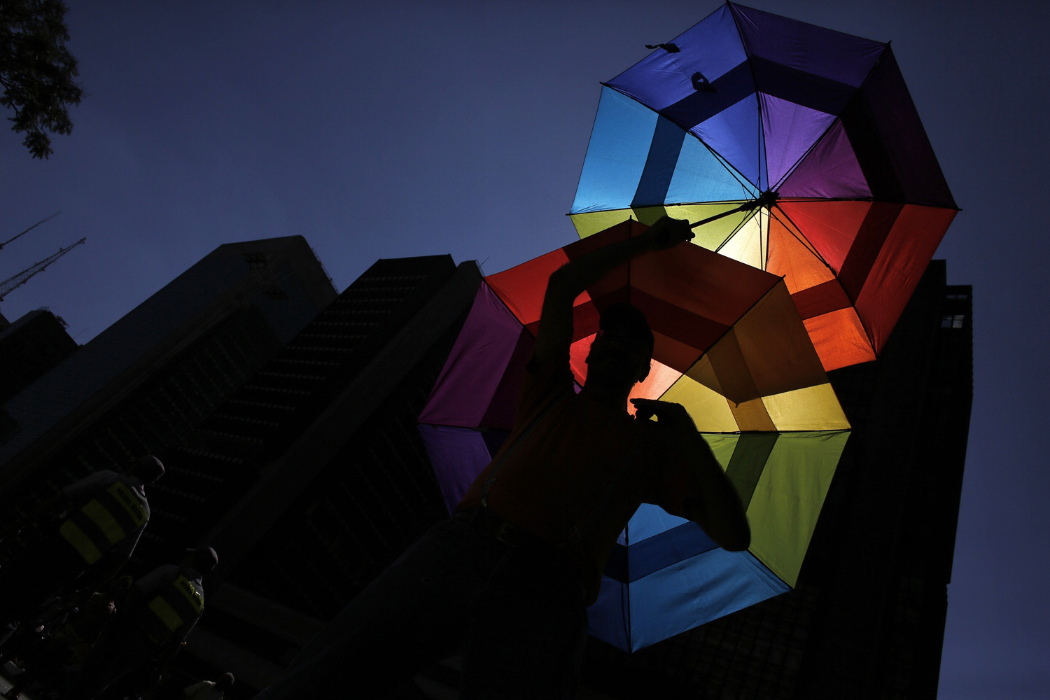 May 4, 2014.  A reveller holds up rainbow colored umbrellas during the 18th Gay Pride Parade in Avenida Paulista in Sao Paulo.