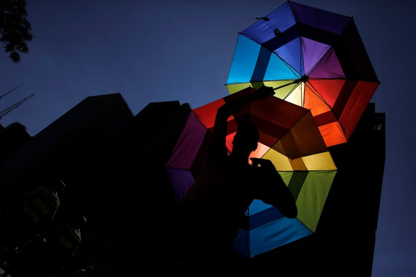 A reveller holds up rainbow coloured umbrellas during the 18th Gay Pride Parade in Avenida Paulista in Sao Paulo