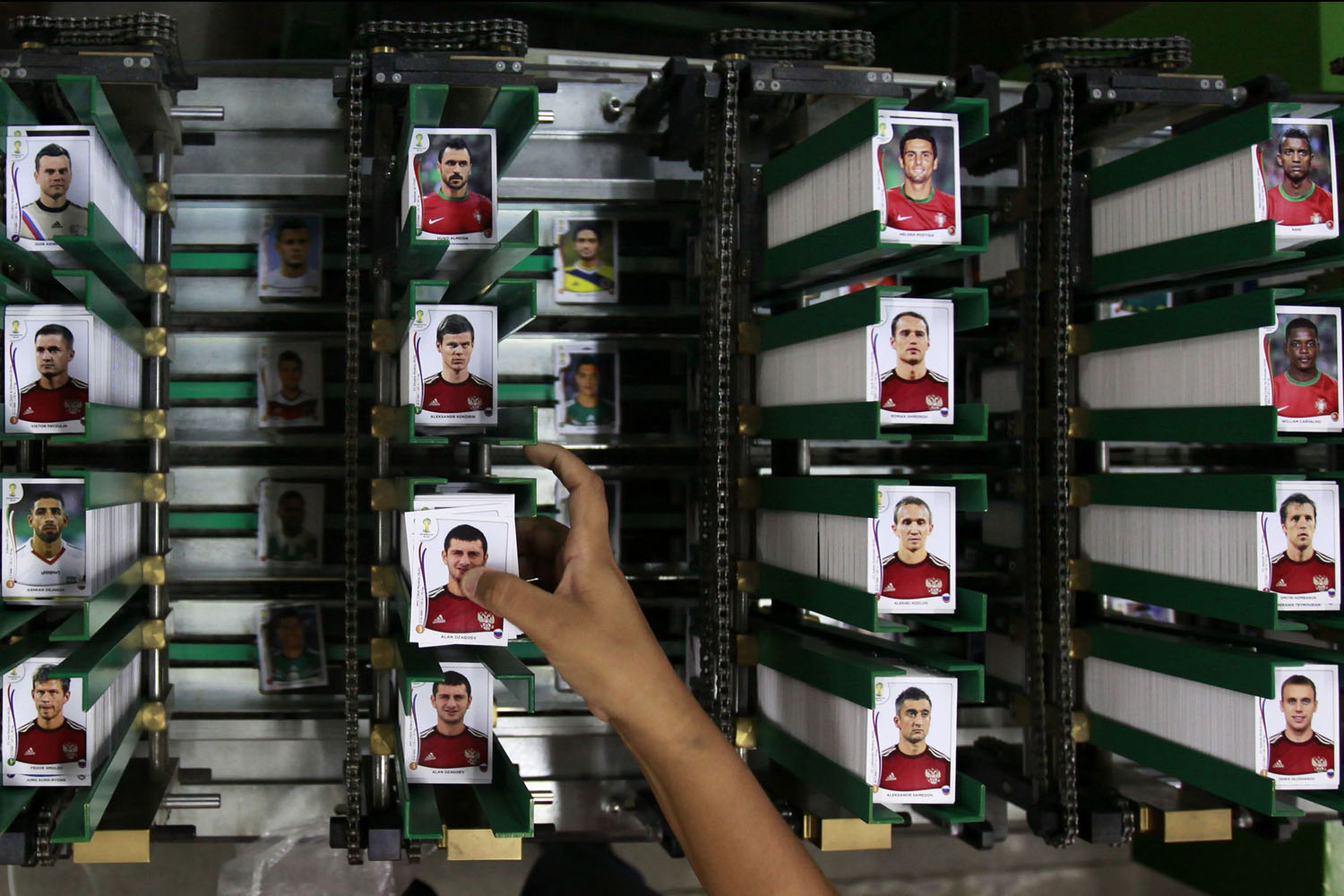 May 5, 2014. A labourer works at the assembly line of Panini's factory, where the FIFA's Brazil World Cup stickers and albums are been produced, in Tambore, an industrial suburb north of Sao Paulo, Brazil.