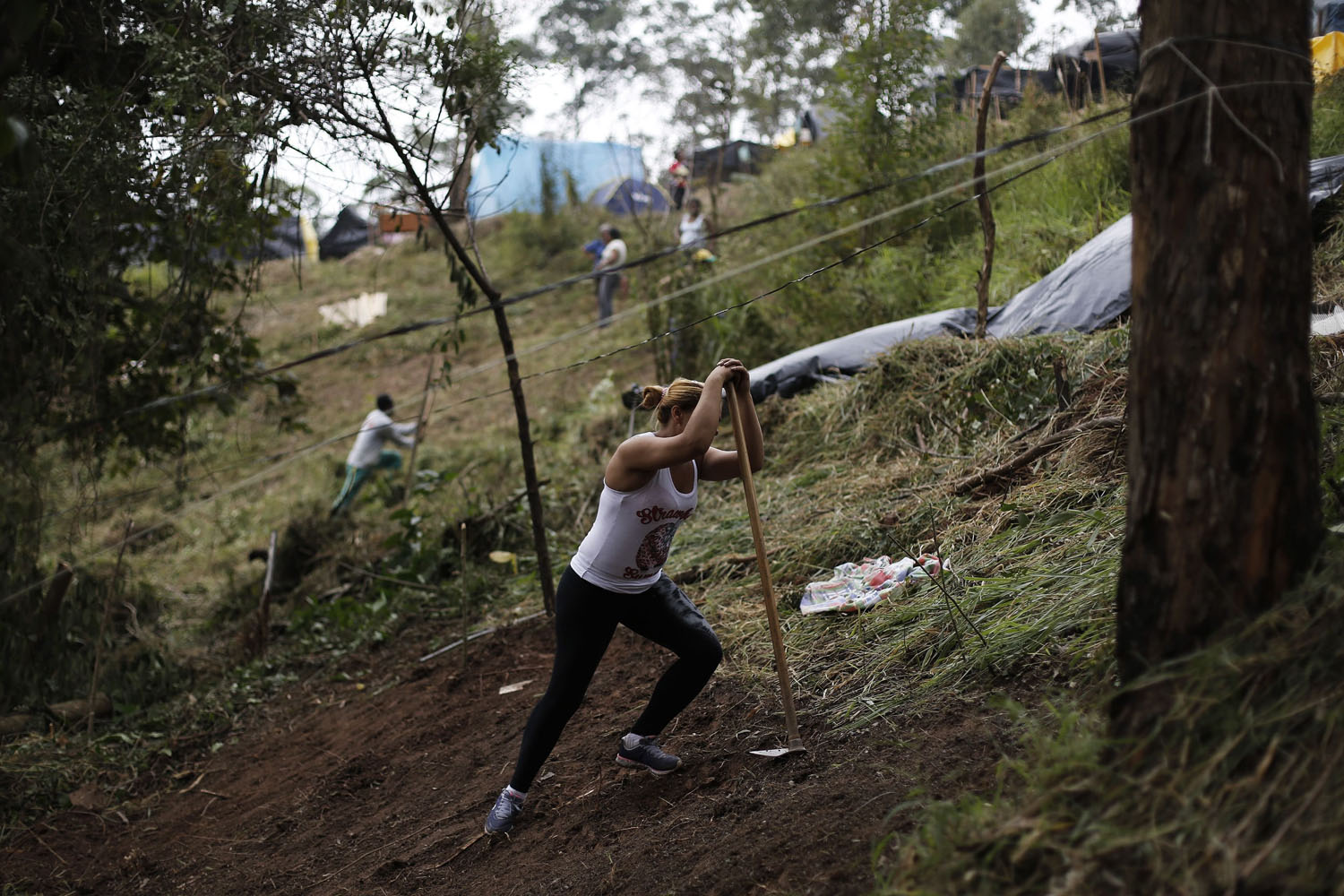 May 7, 2014. A member of Brazil's Homeless Workers' Movement (MTST) rests on her piece of land while building a shack at the  People's World Cup  camp, which houses an estimate of 2,800 families of the movement, in the district of Itaquera near Sao Paulo's World Cup stadium, in Sao Paulo  Brazil.