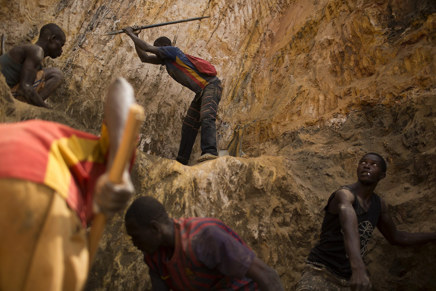 May 9, 2014. Prospectors work at an open-pit at the Ndassima gold mine, near Djoubissi north of Bambari.