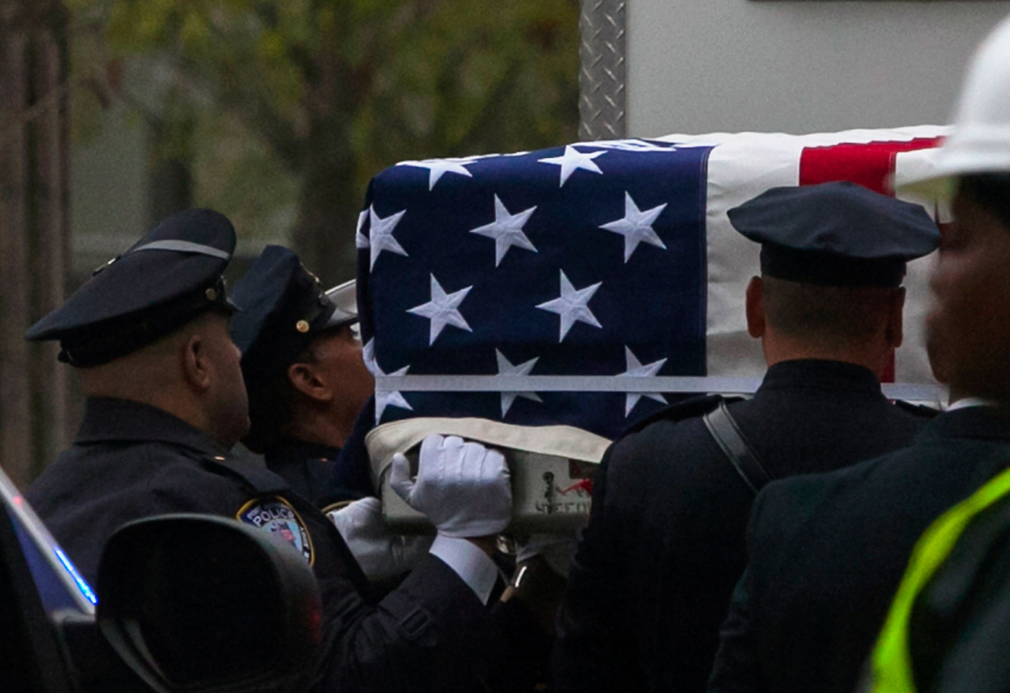Emergency personnel carry a casket draped with a U.S. flag during the ceremonial transfer of the 9/11 unidentified remains to the Office of the Chief Medical Examiner of the City of New York (OCME) repository at the World Trade Center site, in New York May 10, 2014.