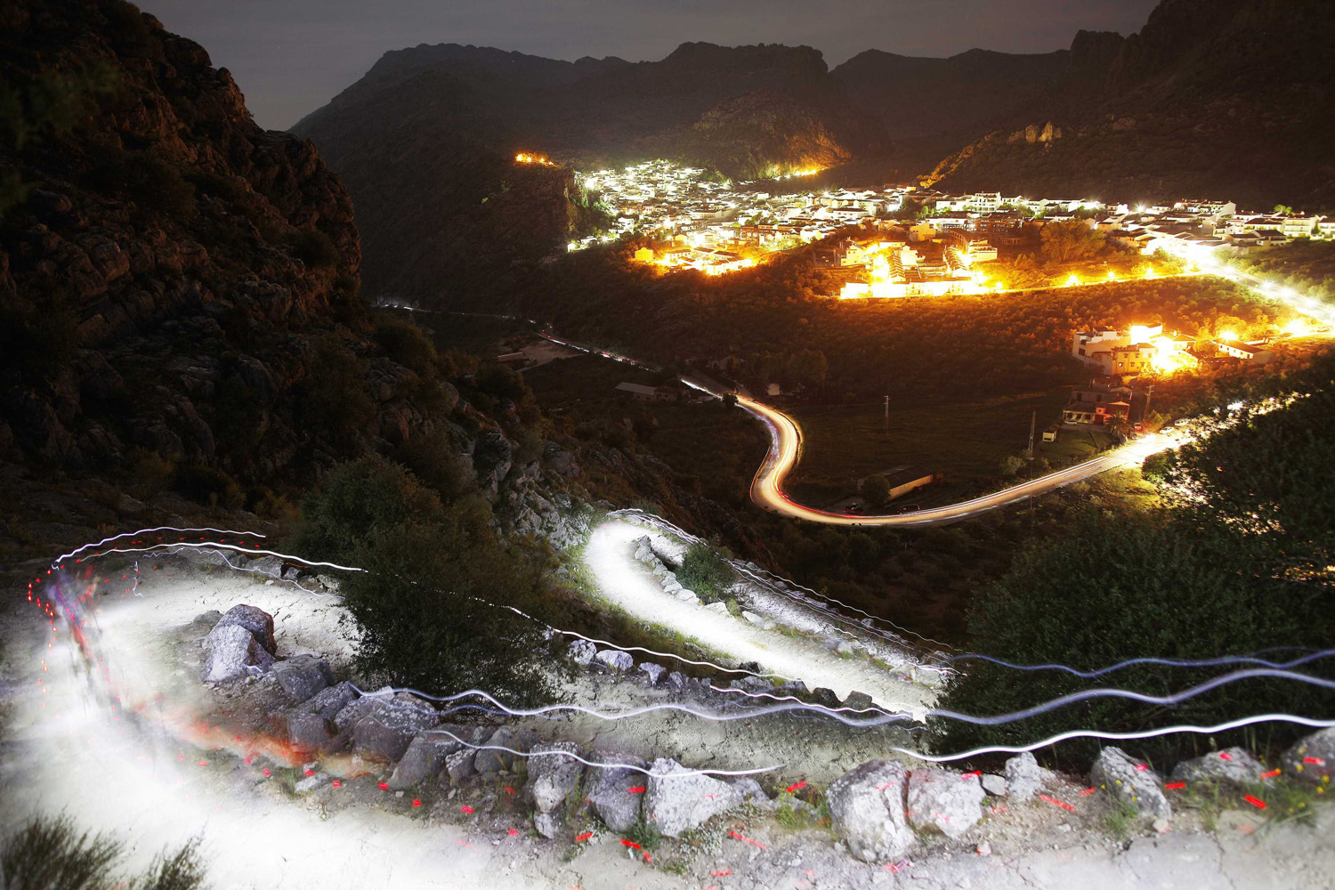 May 11, 2014. Trails of headlamps are seen in the night as runners make their way to the finish line during the XVII 101km competition on a mountain on the outskirts of Montejaque,  southern Spain.